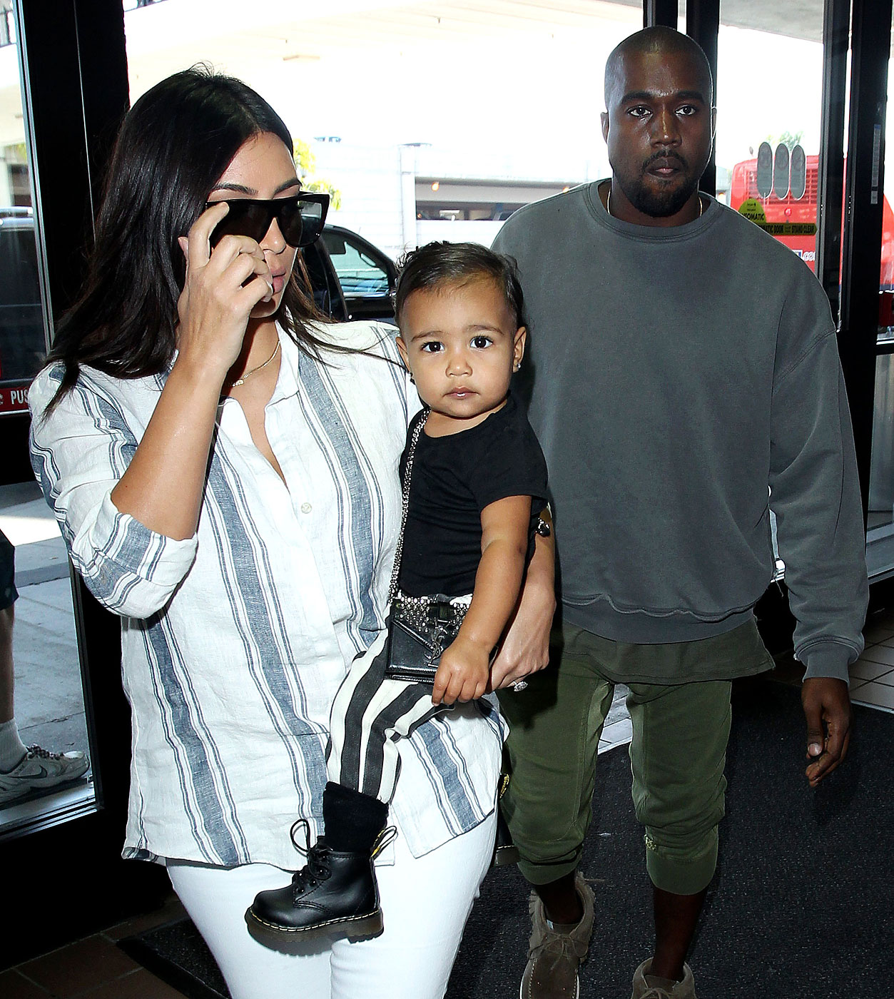 Kim Kardashian, Kanye West and baby North West at the Los Angeles International Airport on Sept. 1, 2014.