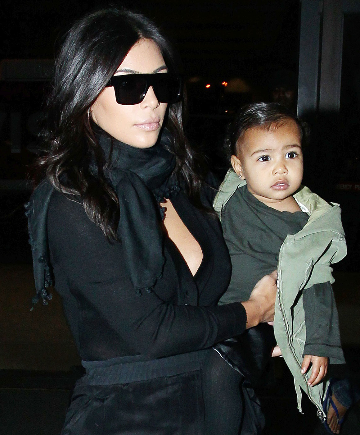 Kim Kardashian, husband Kanye West and baby North West depart from Los Angeles International Airport on Sept. 1, 2014.