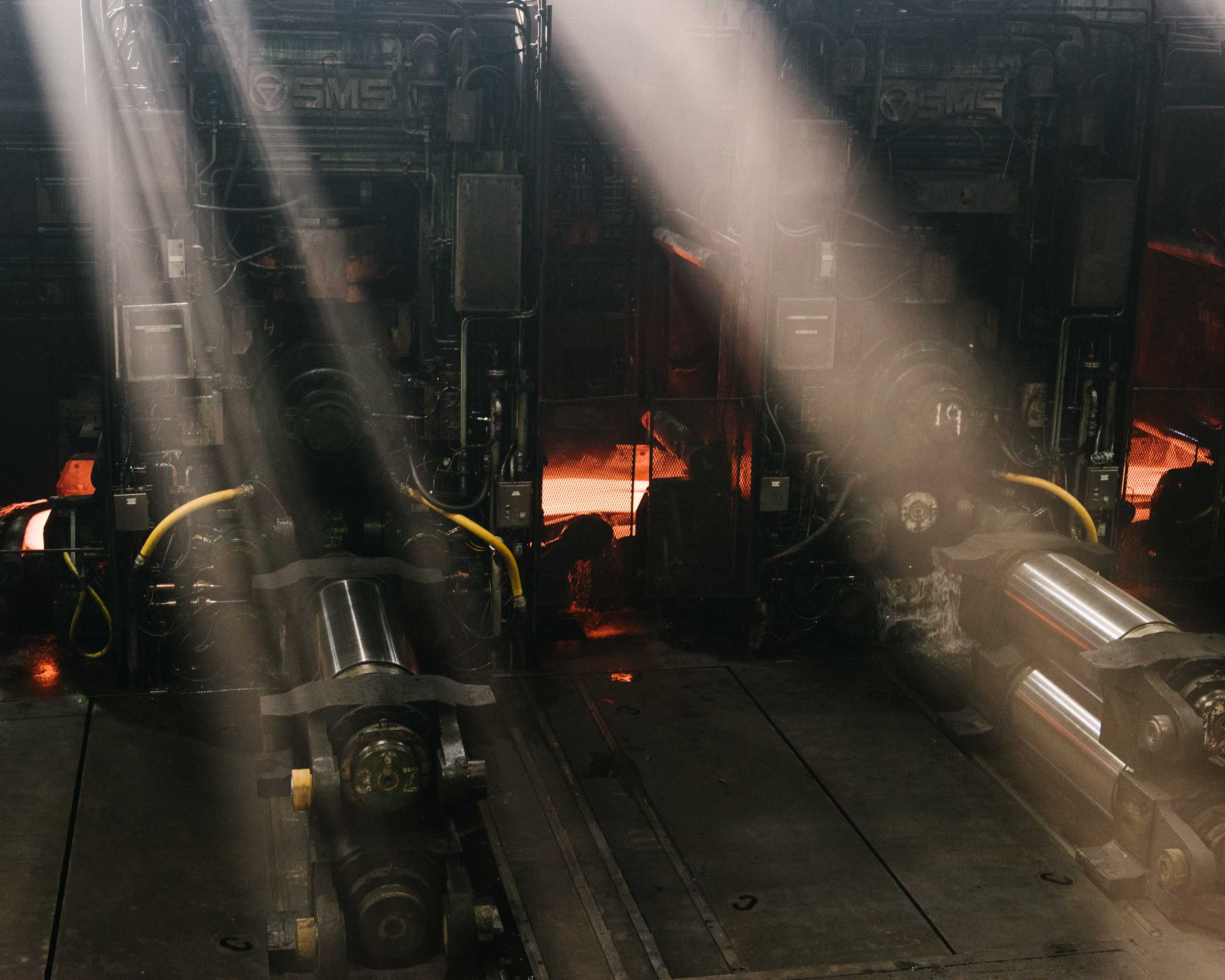 In the rolling mill, two-inch thick, red-hot slabs of steel are rapidly pounded into sheets thinner than cardboard, Crawfordsville, Ind. on Aug. 25, 2014.