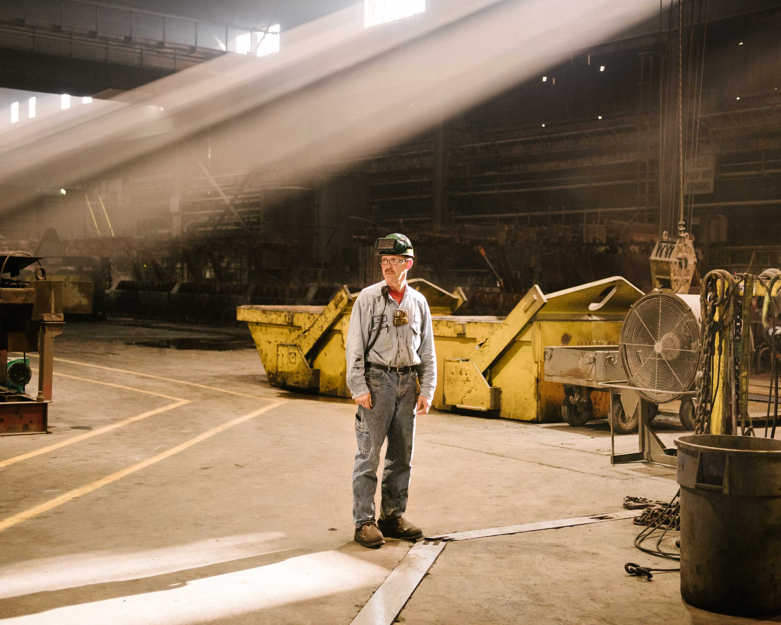 "Rolling mill technician Mike Hutchinson oversees the steel's thinning process. ""Our machines got ump,"" he says, Crawfordsville, Ind. on Aug. 25, 2014."