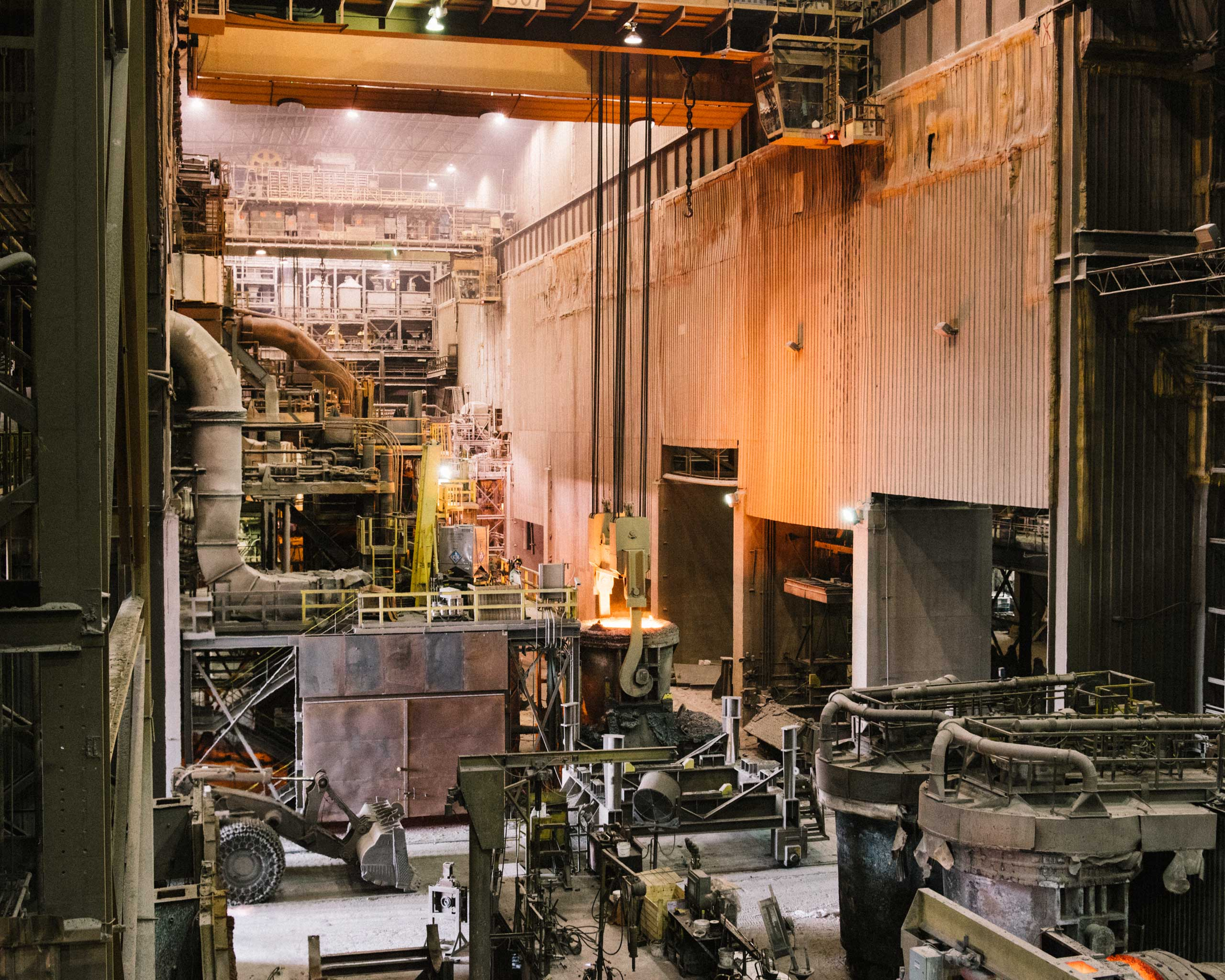 An open ladle with over 100 tons of molten steel is lifted in the center of the mill, Crawfordsville, Ind. on Aug. 25, 2014.