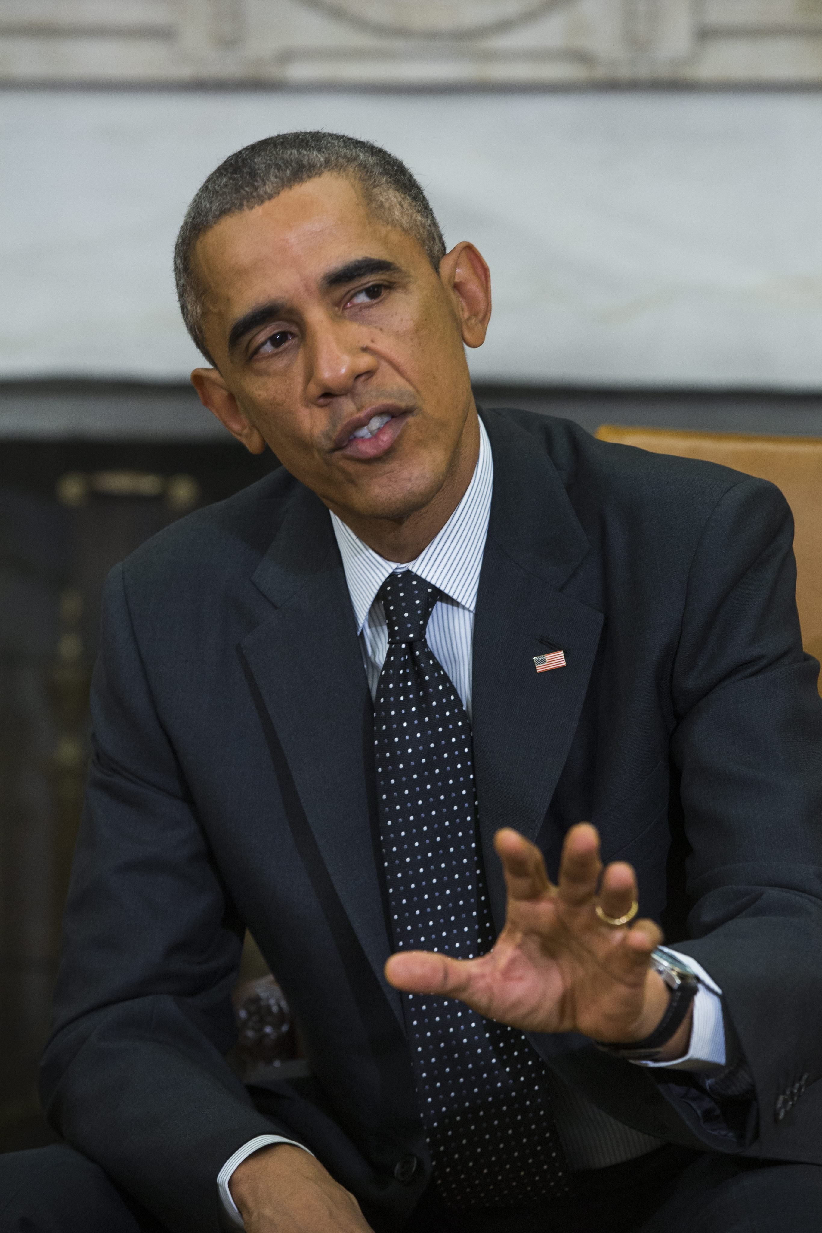 President Barack Obama speaks to the media after holding a meeting with his newly-appointed 'Ebola Response Coordinator' Ron Klain, along with other members of the team coordinating the Obama administration's ebola response efforts, in the Oval Office of the White House in Washington on Oct. 22, 2014.