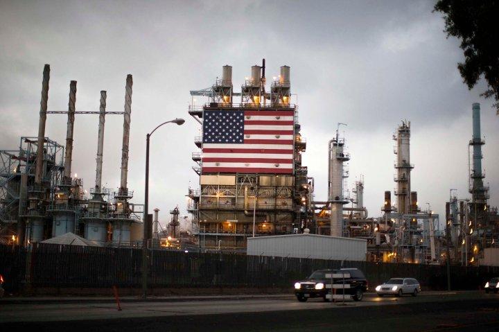 TeThe U.S. flag is displayed at Tesoro's Los Angeles oil refinery in Los Angeles, California