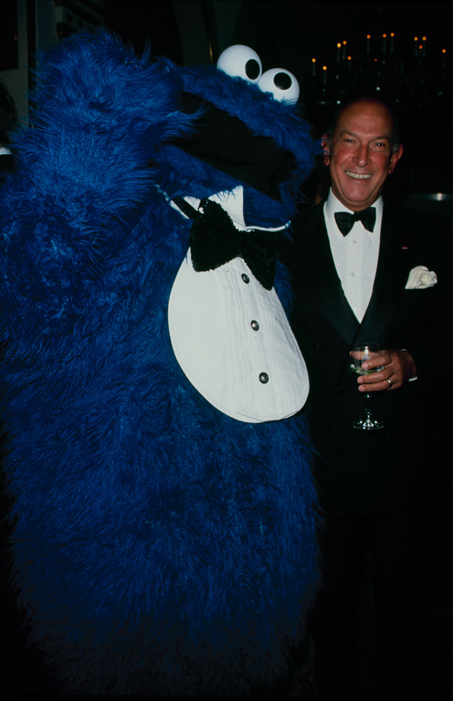 Oscar De La Renta with Sesame Street's Cookie Monster.