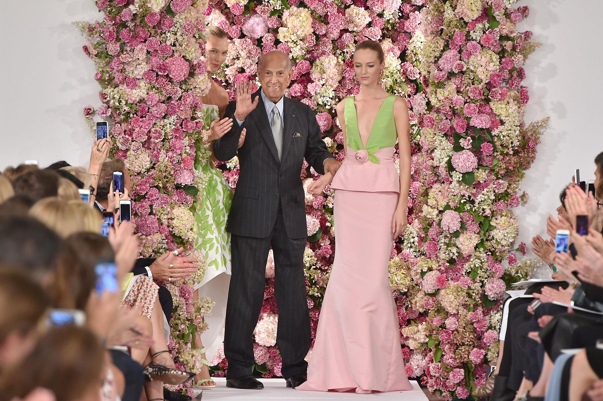 Oscar de la Renta and model Karlie Kloss, left, walk the runway at the Oscar De La Renta fashion show during Mercedes-Benz Fashion Week Spring 2015 on September 9, 2014 in New York City.