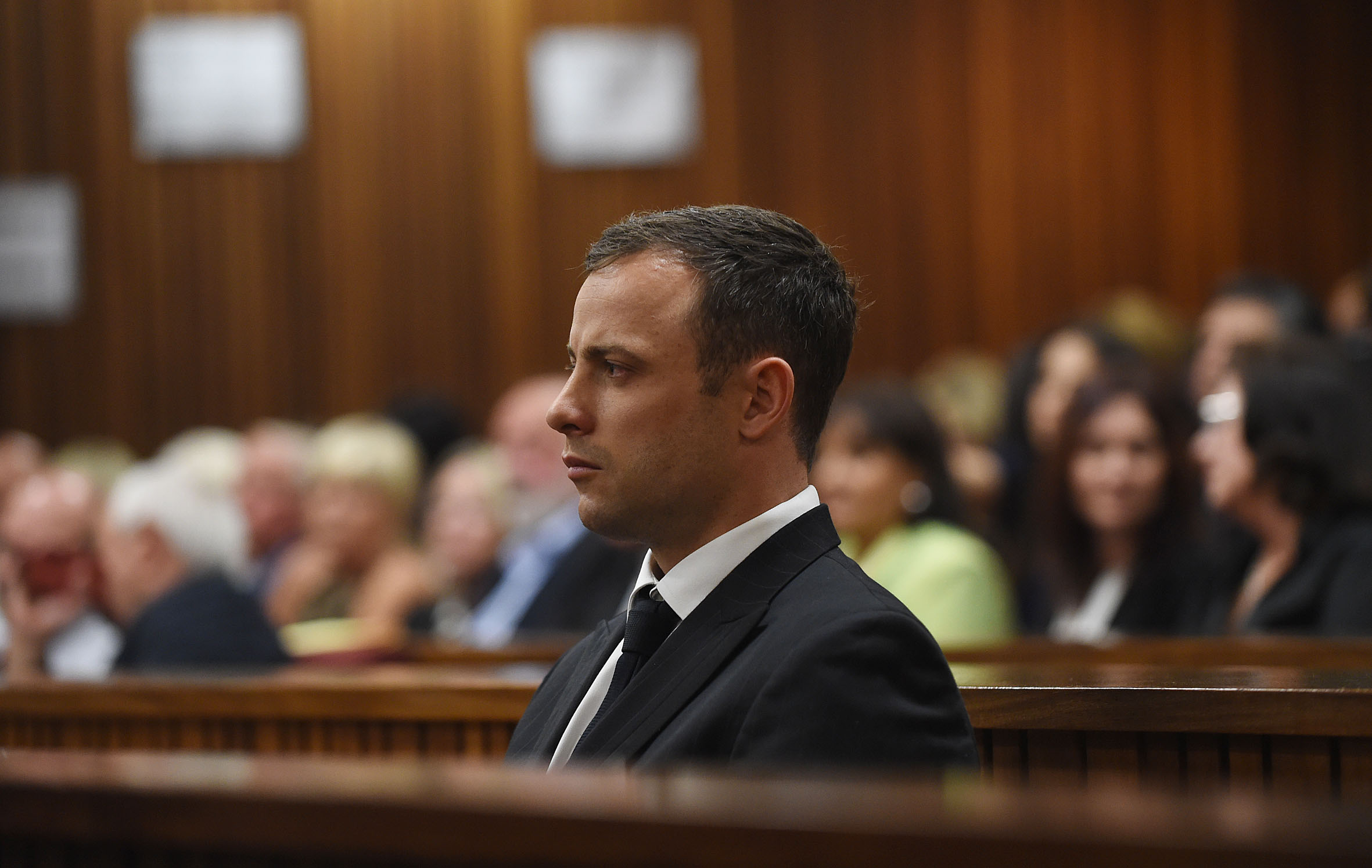 Oscar Pistorius sits in the Pretoria High Court on September 11, 2014, in Pretoria, South Africa.