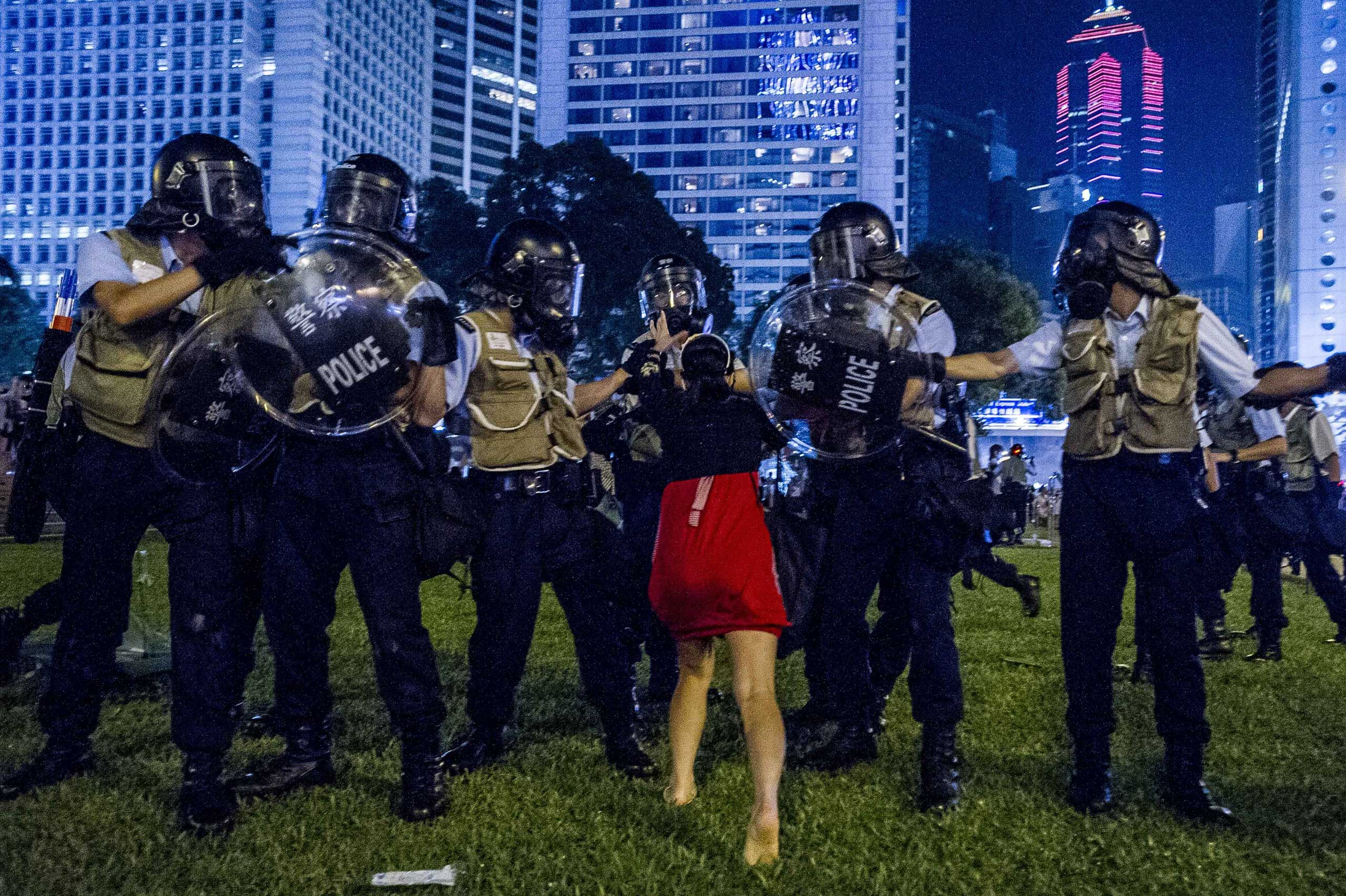 Sept. 28, 2014. A pro-democracy protester confronts the police during a demonstration in Hong Kong. Police fired tear gas as tens of thousands of pro-democracy demonstrators brought parts of central Hong Kong to a standstill on September 28, in a dramatic escalation of protests that have gripped the semi-autonomous Chinese city for days.