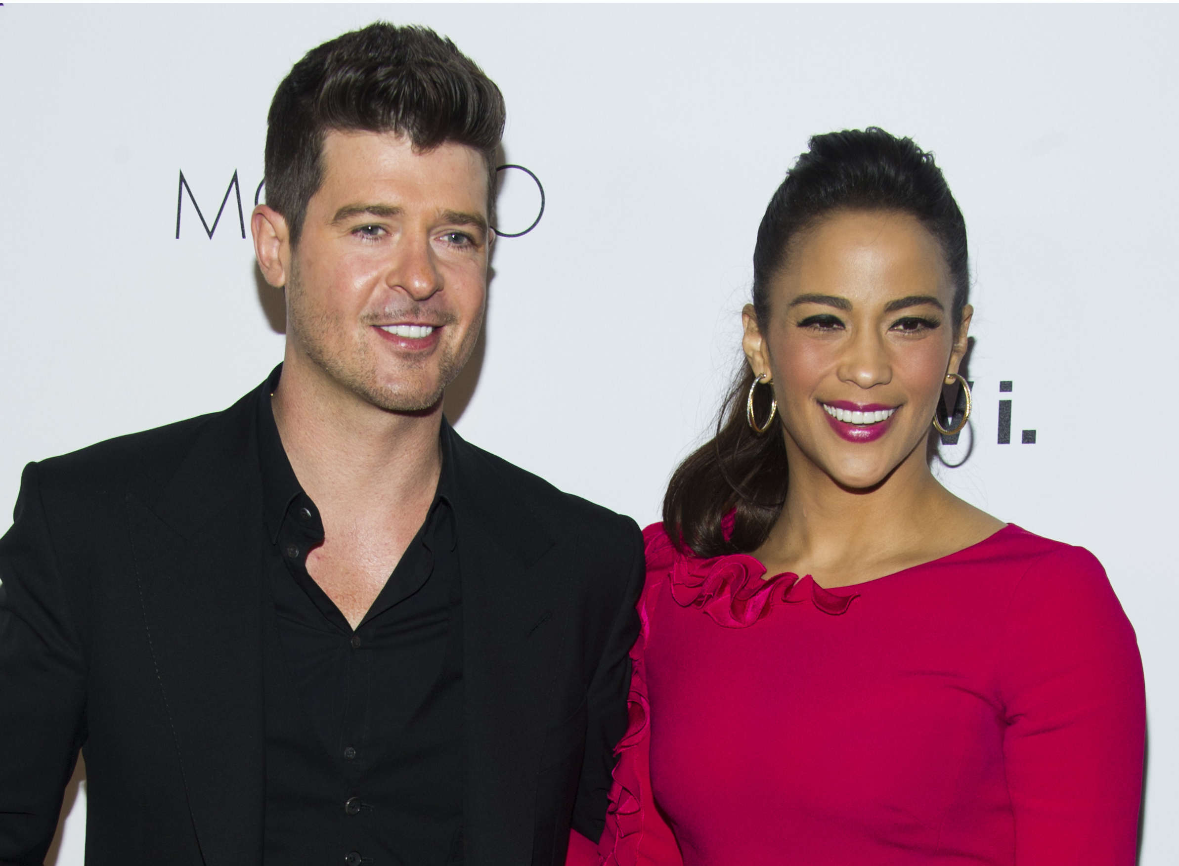 In this Wednesday, Oct. 23, 2013 file photo, Robin Thicke and Paula Patton attend the sixth annual GQ Gentlemen's Ball in New York.