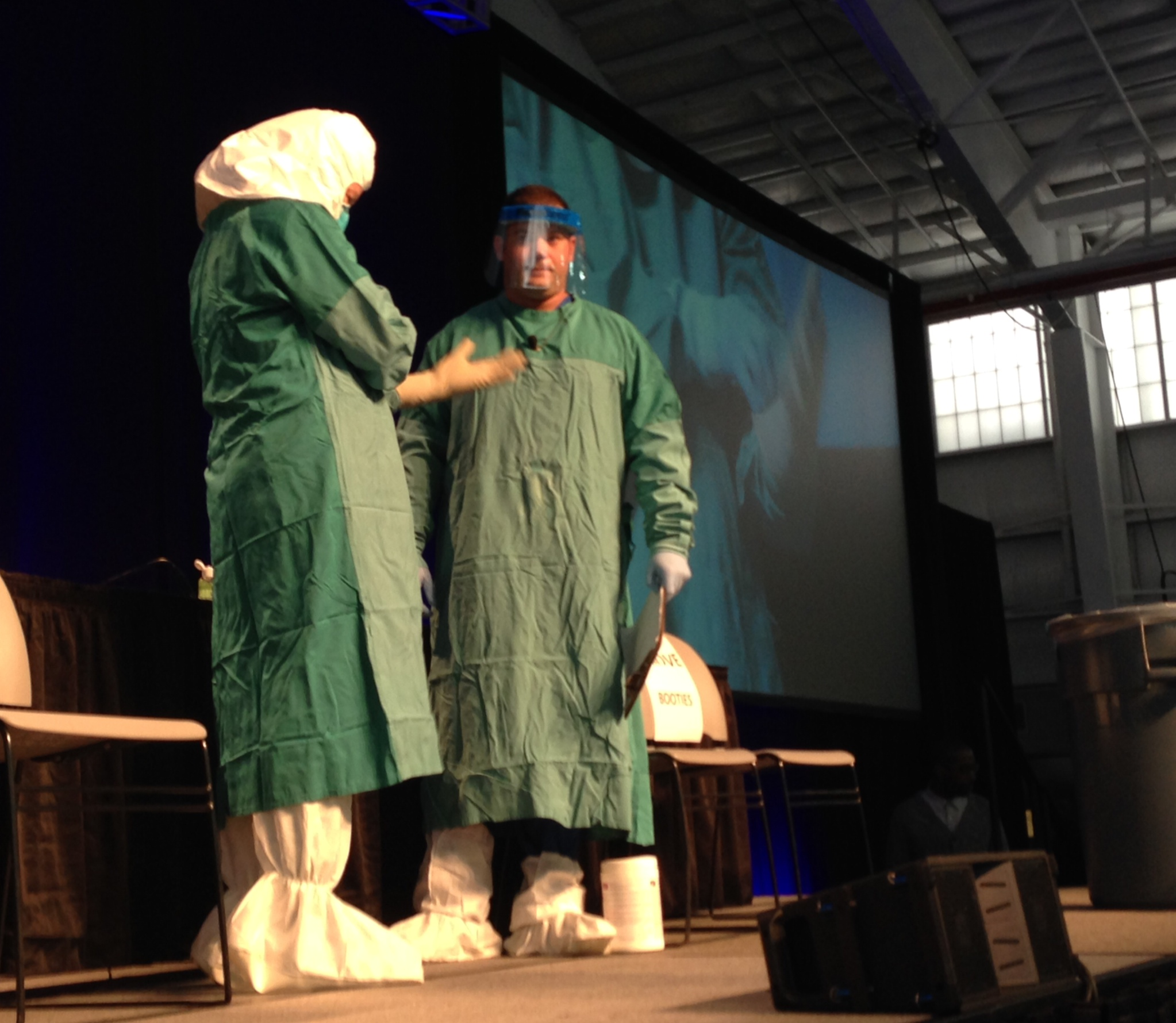 CDC and Mount Sinai health workers demonstrate how to put on and off Ebola personal protective equipment at an Ebola education session in New York City