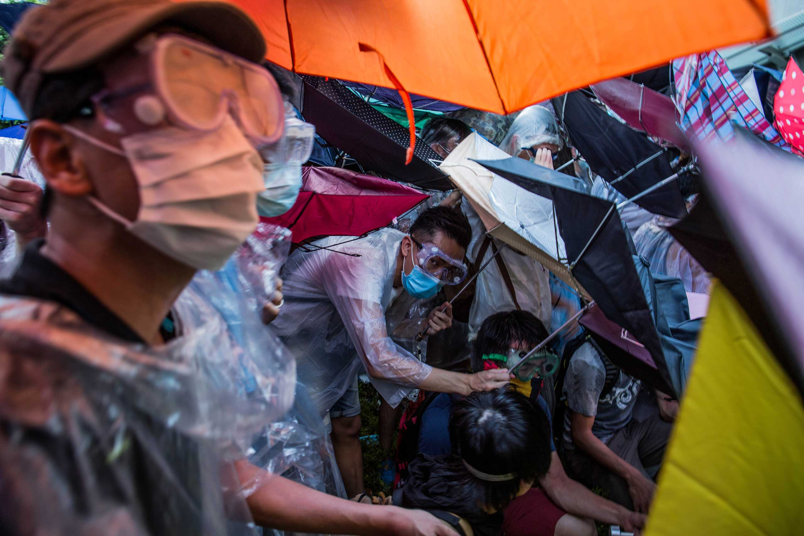 Sept. 28, 2014. More than 50,000 demonstrators closed down the main thoroughfare connecting Central and Admiralty in Honk Kong, China. Protesters created a force field of umbrellas to protect them from pepper spray.