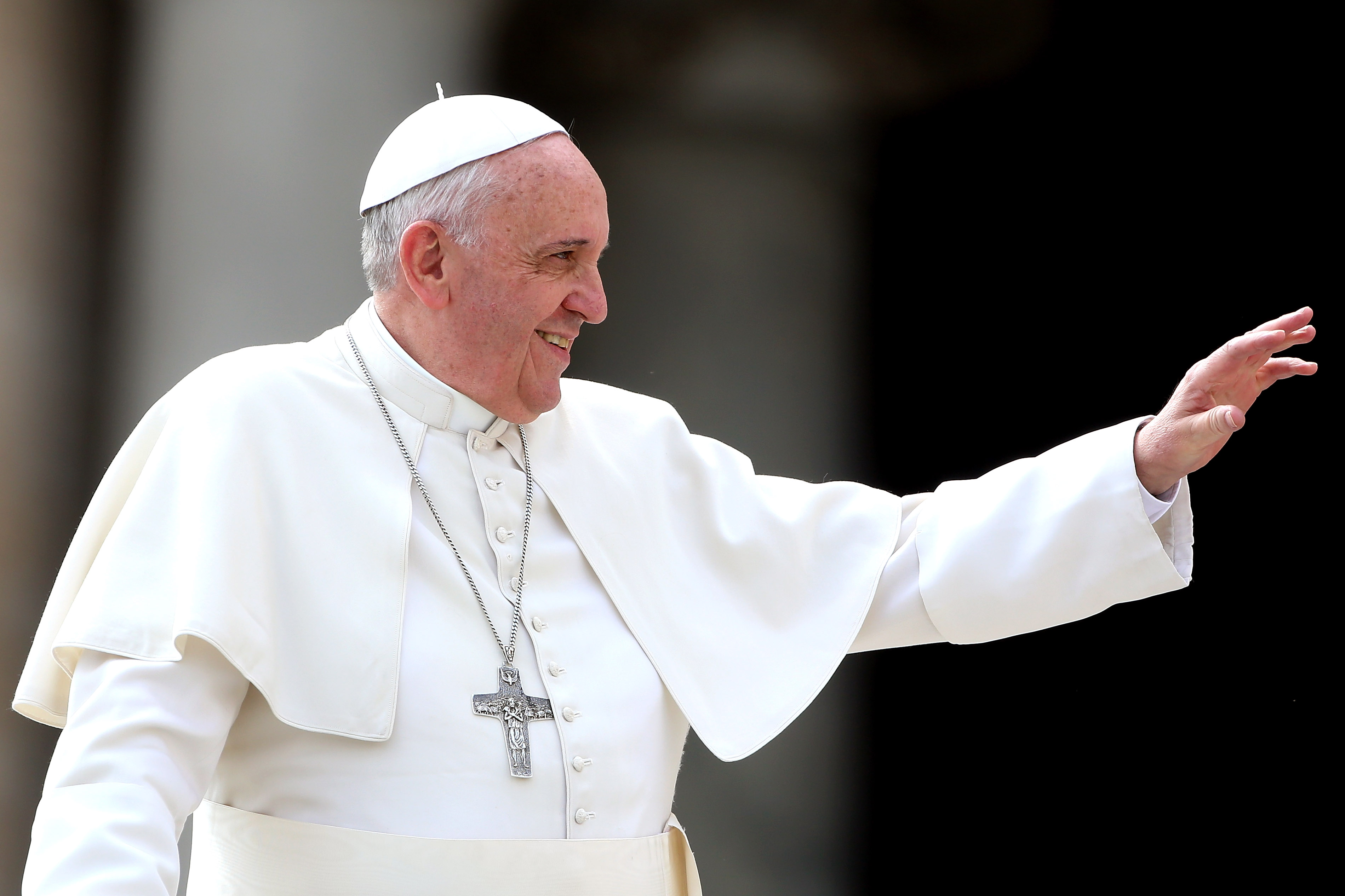 Pope Francis waves to the faithful as he holds his weekly audience in St. Peter's Square on March 19, 2014 in Vatican City, Vatican.