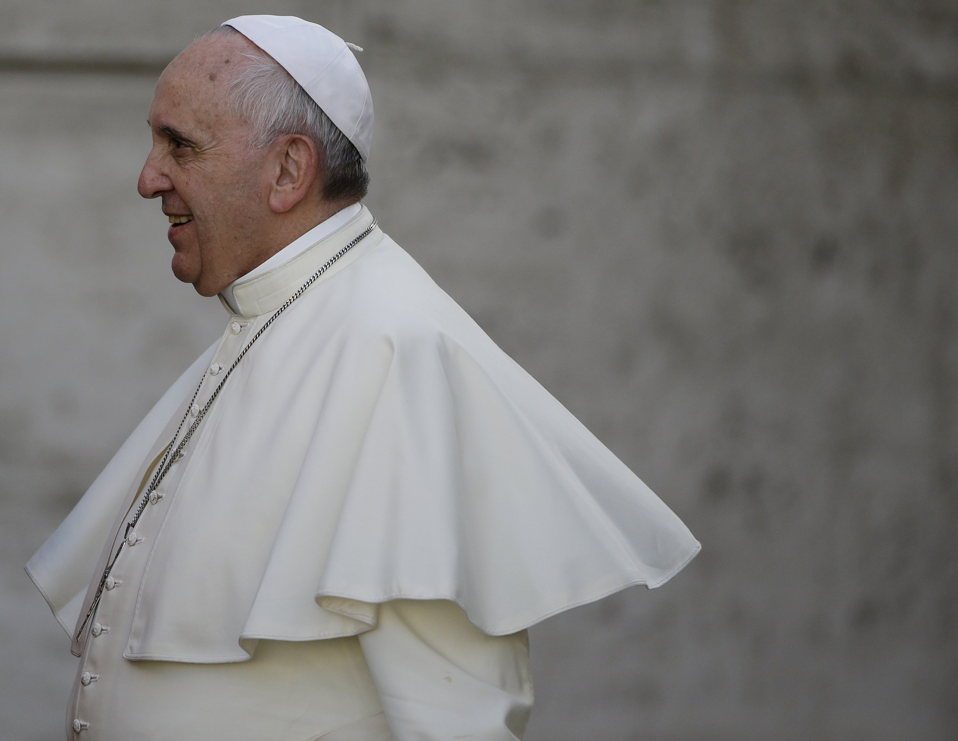 Pope Francis arrives for an afternoon session of a two-week synod on family issues at the Vatican on Oct. 9, 2014. a
