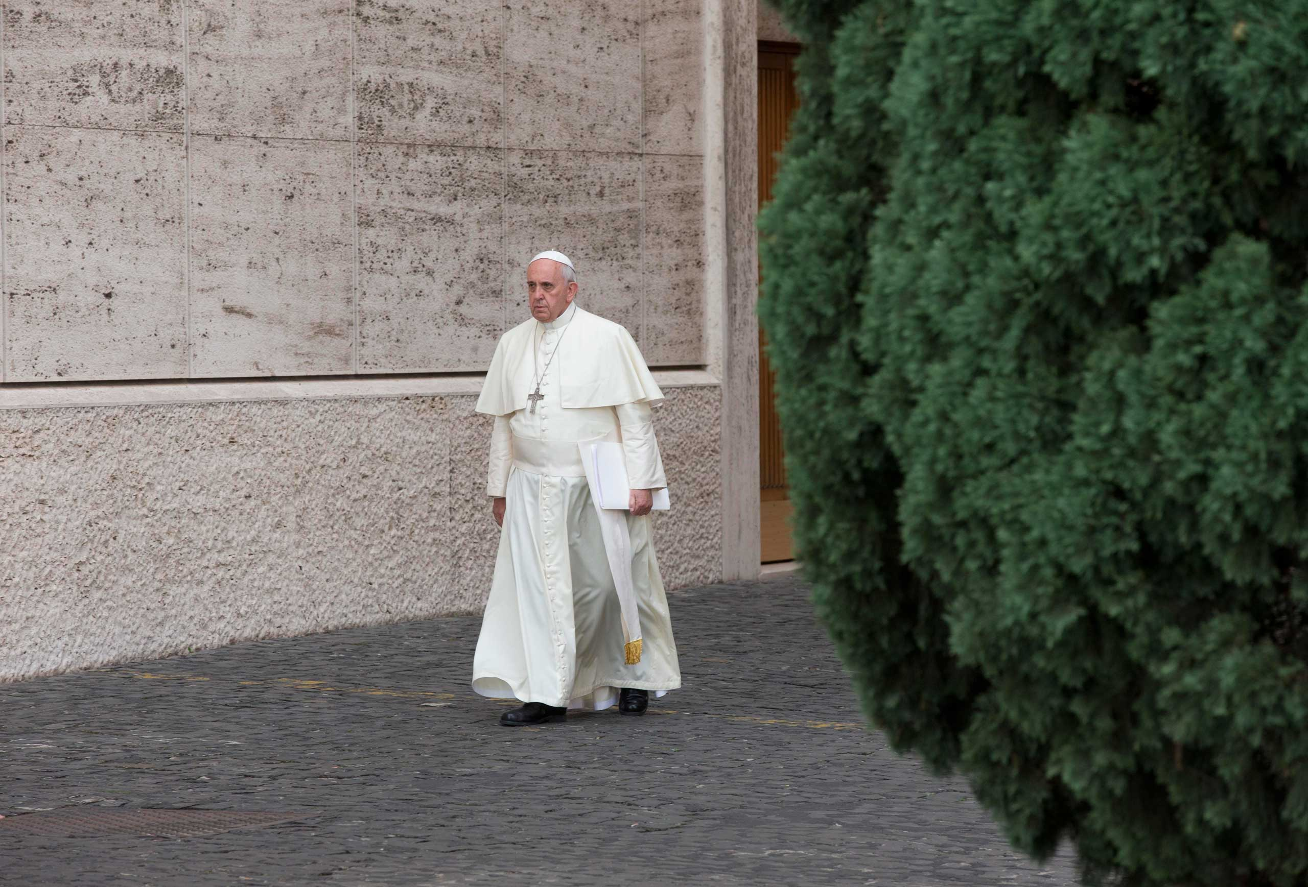 Pope Francis arrives at a morning session of a two-week synod on family issues, at the Vatican, Oct. 16, 2014.