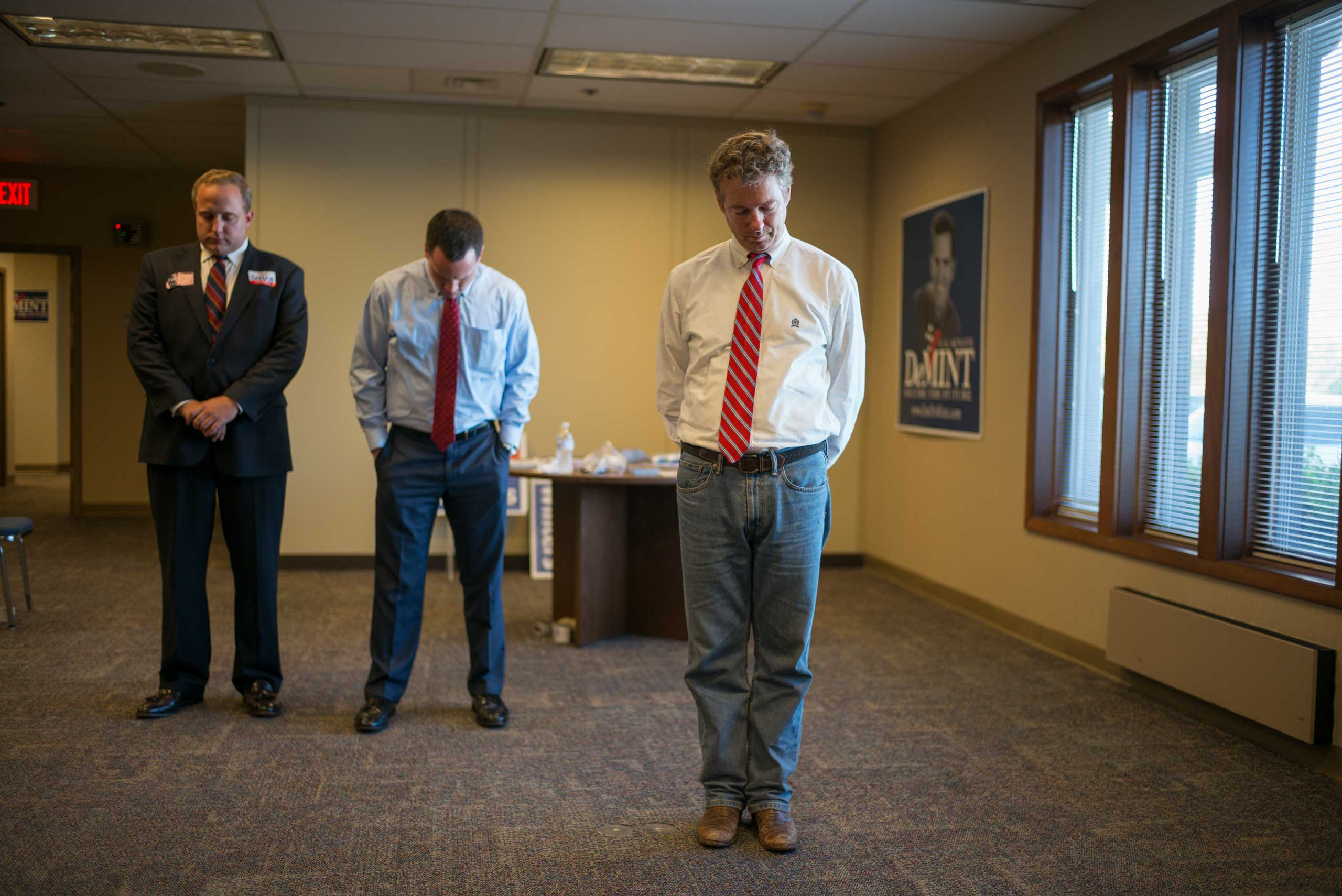 Senator Rand Paul bows his head in prayer before talking to voters at the Horry County Republican Party in Myrtle Beach, S.C. on Sept. 30th, 2014.