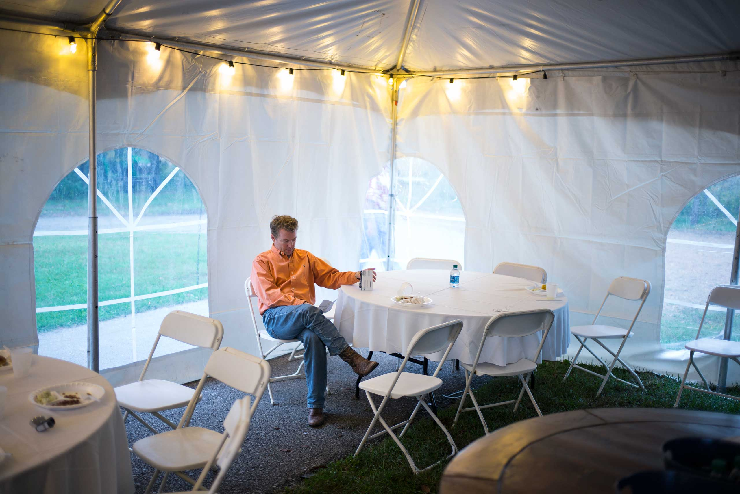 In a back tent, Senator Paul manages to have five minutes alone to go over his speech at the Donnelly Barn in Bowling Green, Ky. on Oct. 12, 2014.