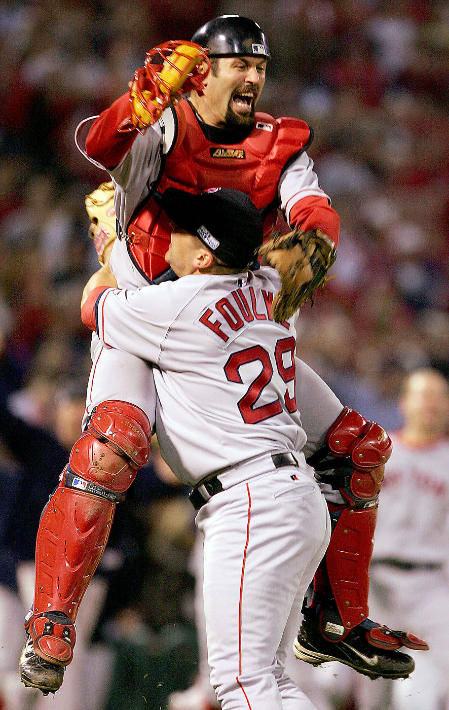 Jason Varitek and Keith Foulke of the Boston Red Sox celebrate after defeating the St. Louis Cardinals 3-0 in game four of the World Series on October 27, 2004 at Busch Stadium in St. Louis, Missouri.