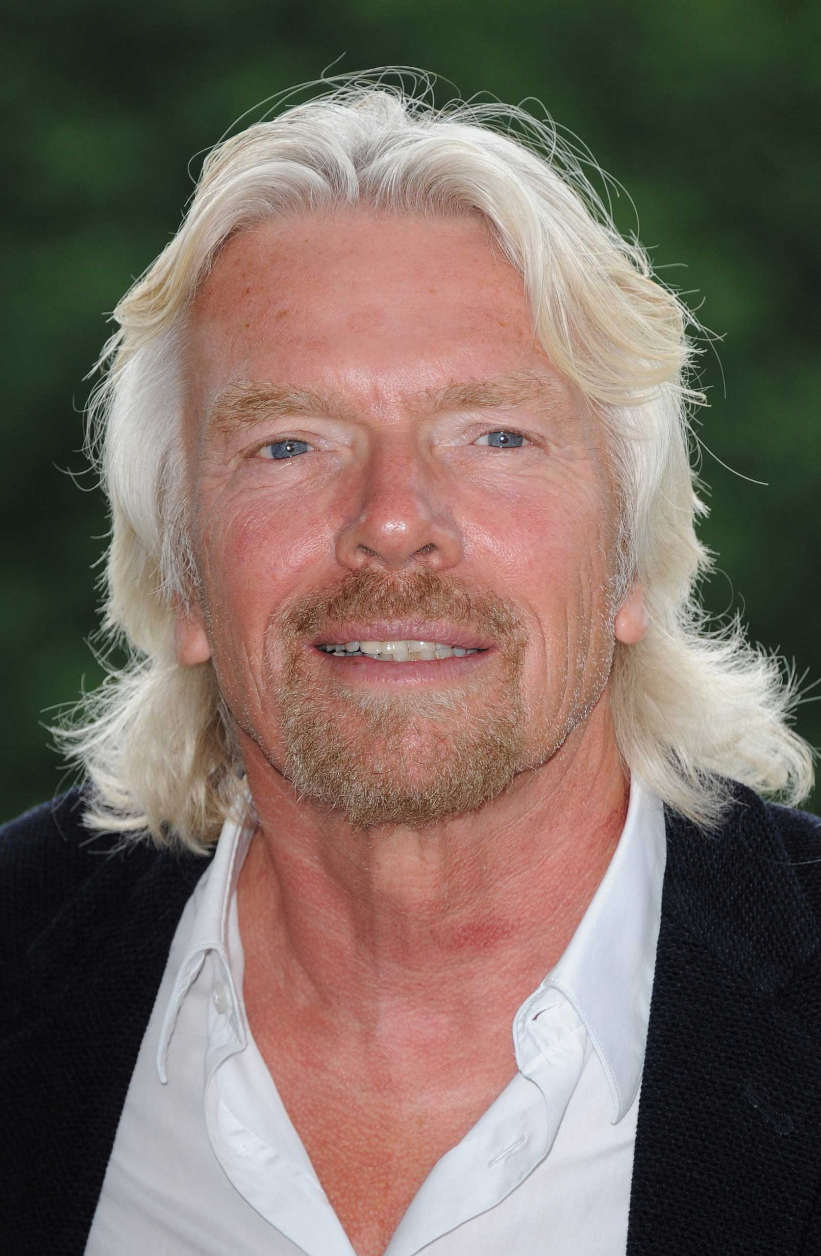 Sir Richard Branson attends a photocall to reveal his celebrity team taking part in this year's Virgin Active London Triathlon at Virgin Active Chiswick Riverside on July 3, 2012 in London.