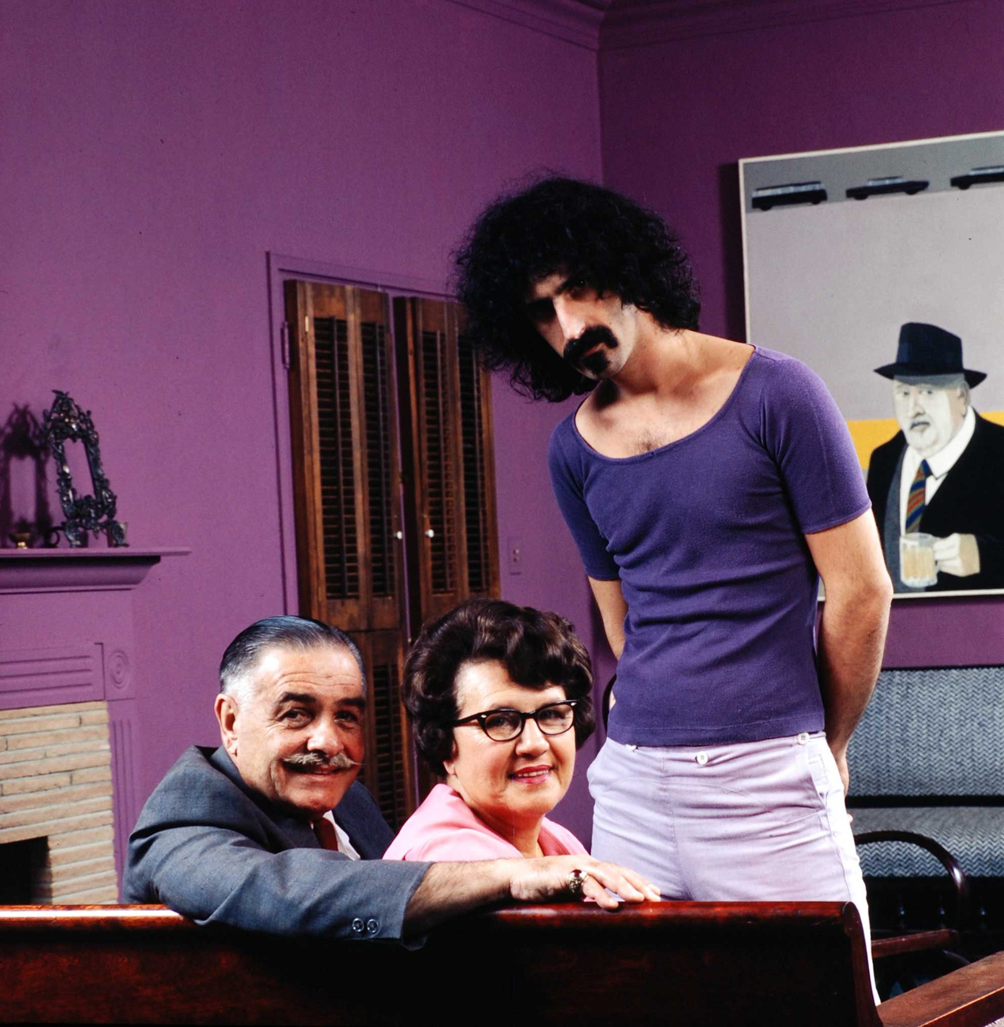 <b>Not published in LIFE.</b> Frank Zappa in his eclectic Los Angeles home with his cat, his dad, Francis and his mom, Rosemarie, in 1970.