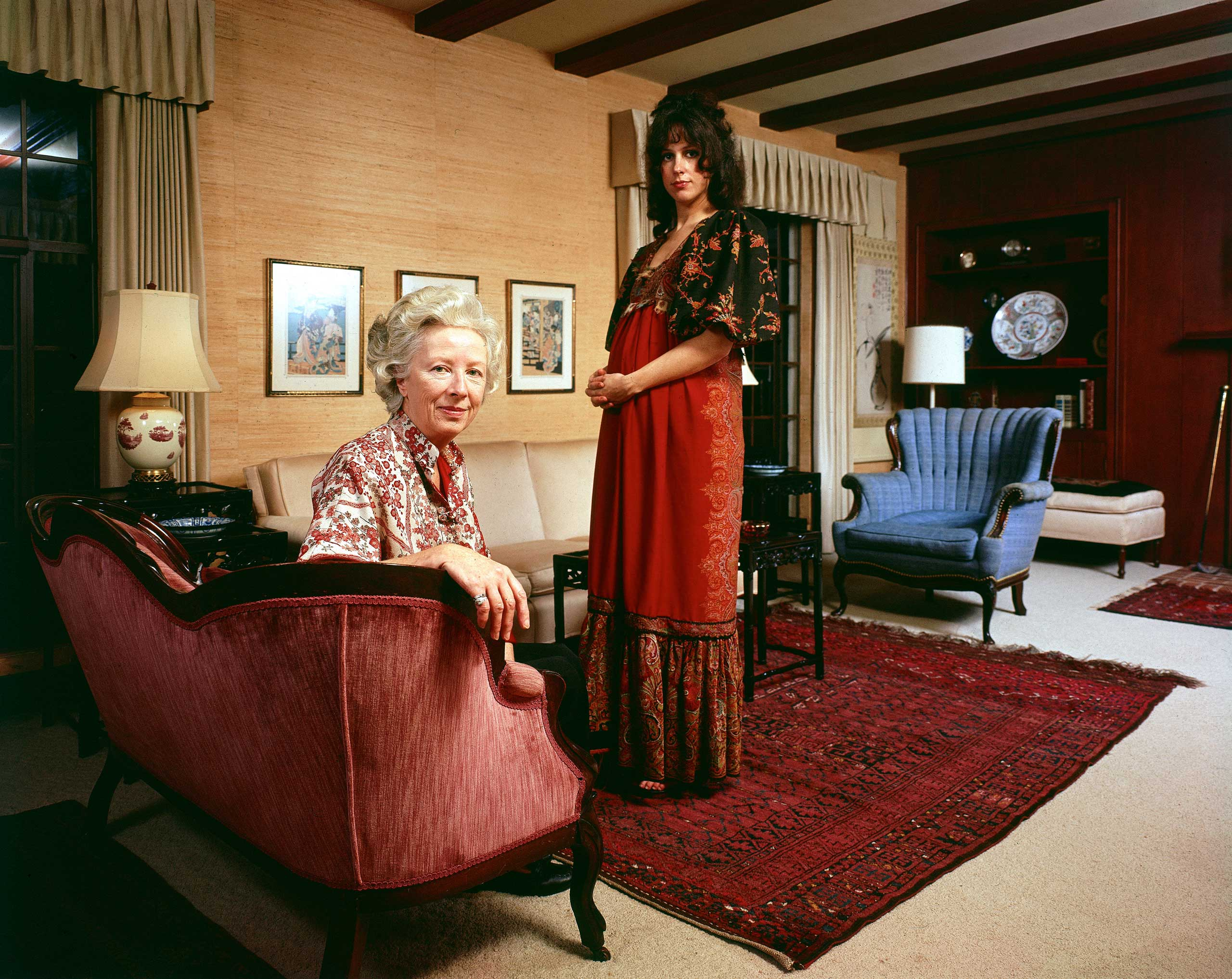 "The Jefferson Airplane's Grace Slick poses with her mother, Virginia Wing, in the living room of the home where she grew up in Palo Alto, California in 1970. ""We raced out there because she was nine months pregnant,"" remembers Olson. ""And the rest of the story took so long to complete, her daughter was a year old when it finally ran."""