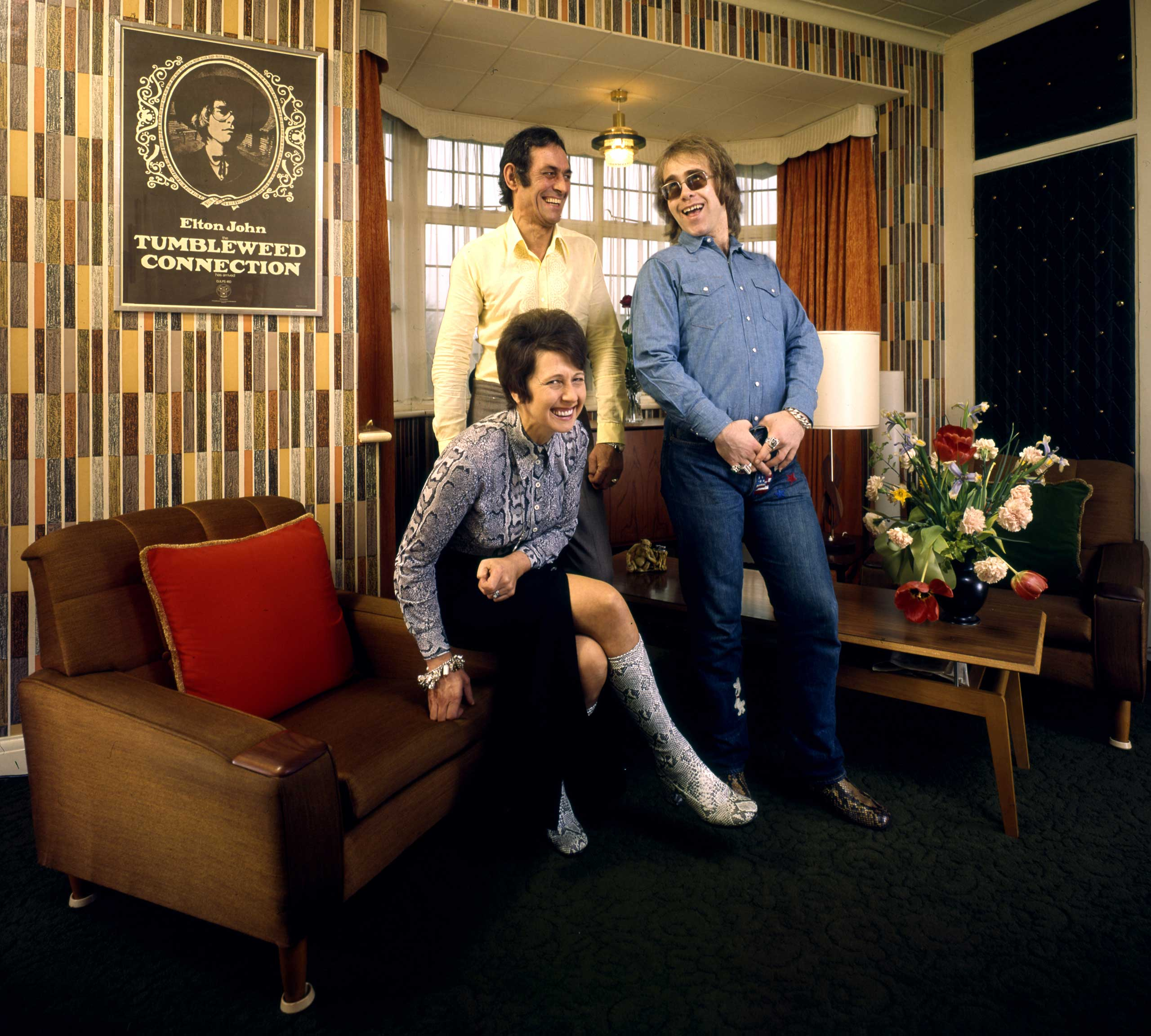 "<b>Not published in LIFE.</b> The former Reggie Dwight, later known as Elton John, laughs with his mom Sheila Fairebrother and her husband Fred (whom he affectionately called ""Derf,"" Fred spelled backwards) in their suburban London apartment in 1970."