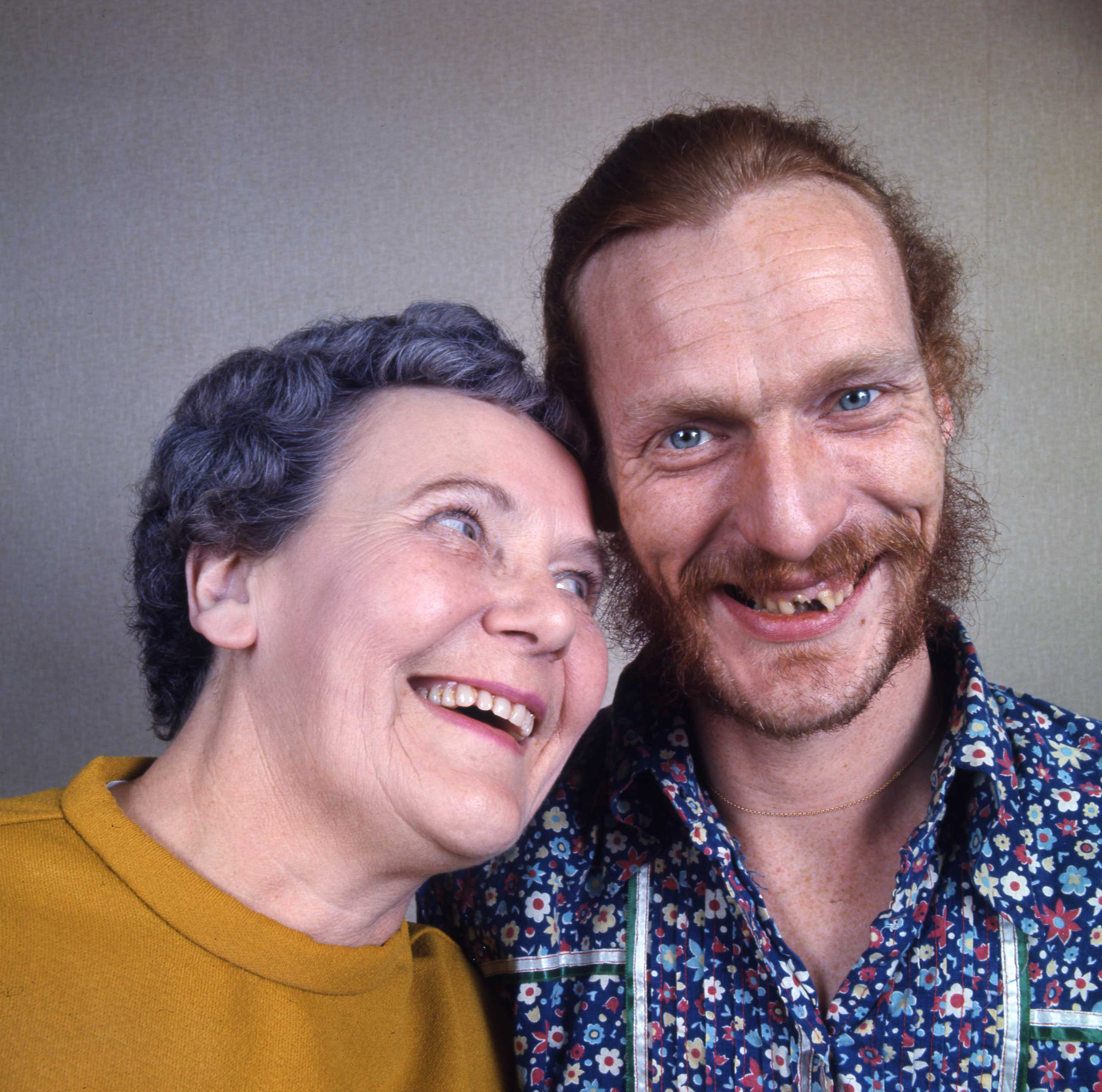 <b>Not published in LIFE.</b> Ginger Baker, the Cream and Blind Faith drummer, flashes a rare smile with his mother Ruby Streatfield inside her rowhouse in Bexley, outside London, in 1970.