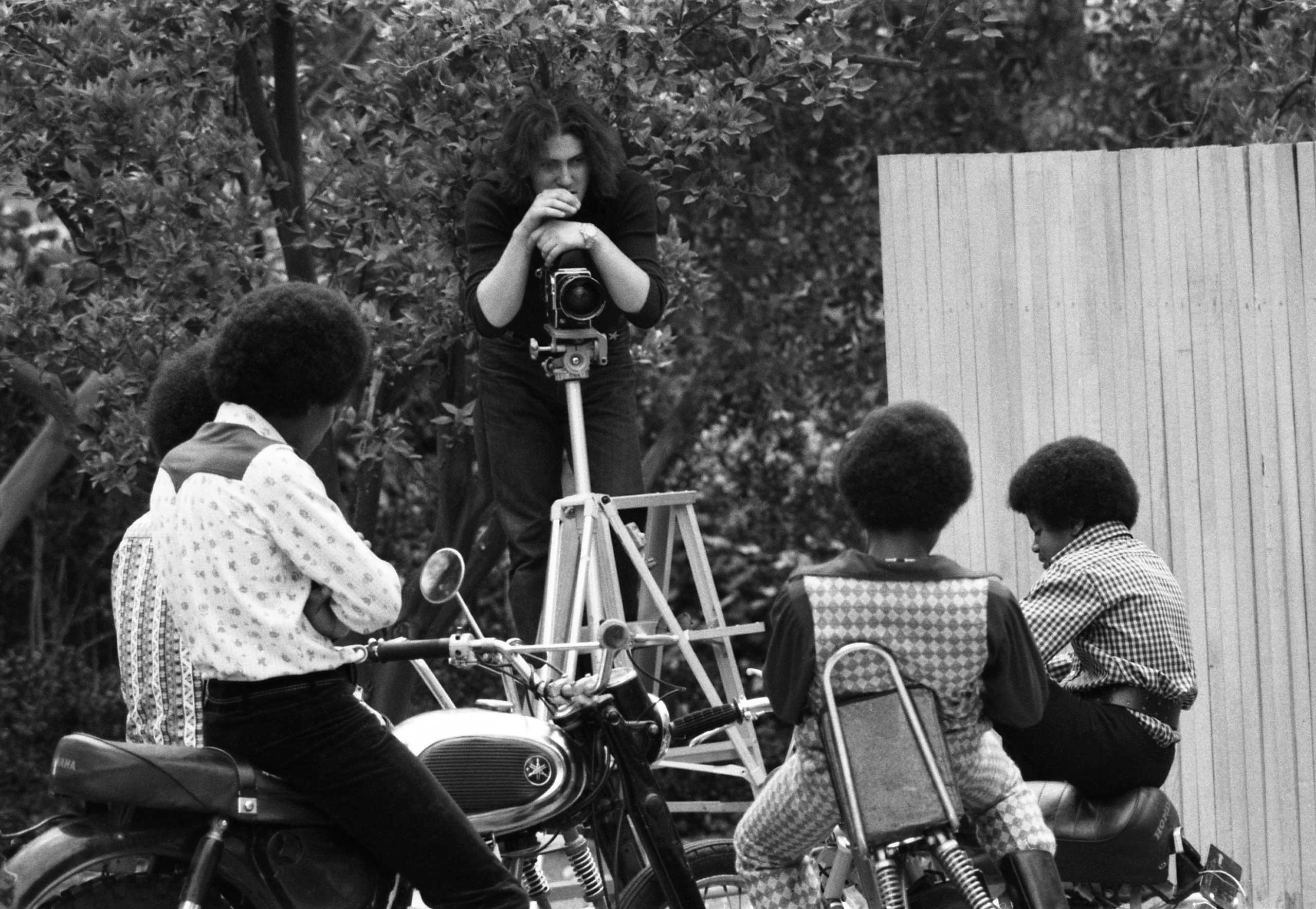 LIFE photographer John Olson sets up to shoot the Jackson 5 in their backyard in 1970.