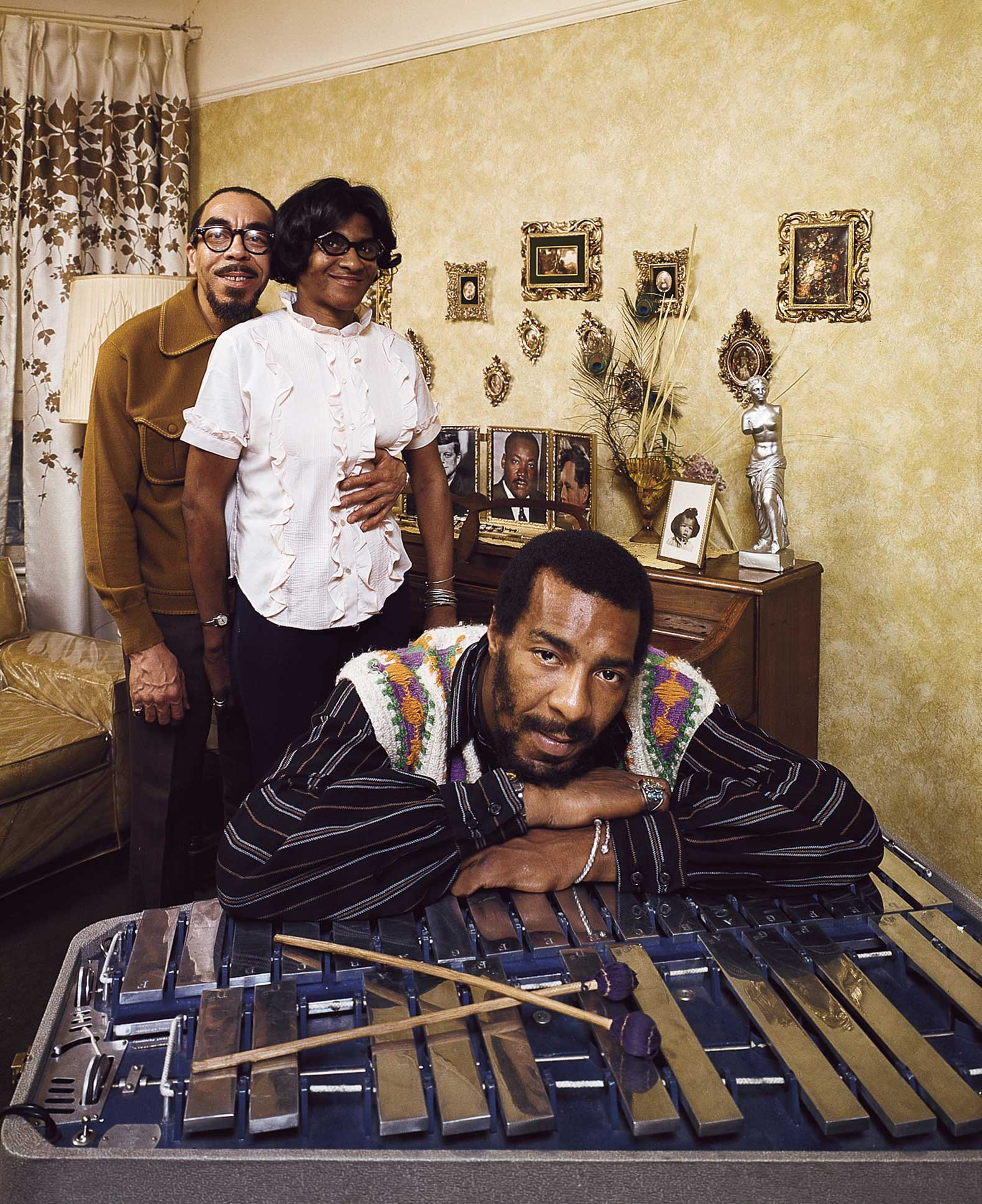 "Richie Havens with his parents, Brooklyn in 1970. The musician who opened the show at Woodstock grew up with his folks, Richard and Mildred, in Bedford-Stuyvesant, Brooklyn, but he bought them this home in nearby East Flatbush when his music career took off. The Havenses had nine kids and, as Mrs. Havens told LIFE, ""Richie is the only one who's really moved away. I can't get rid of most of them."""