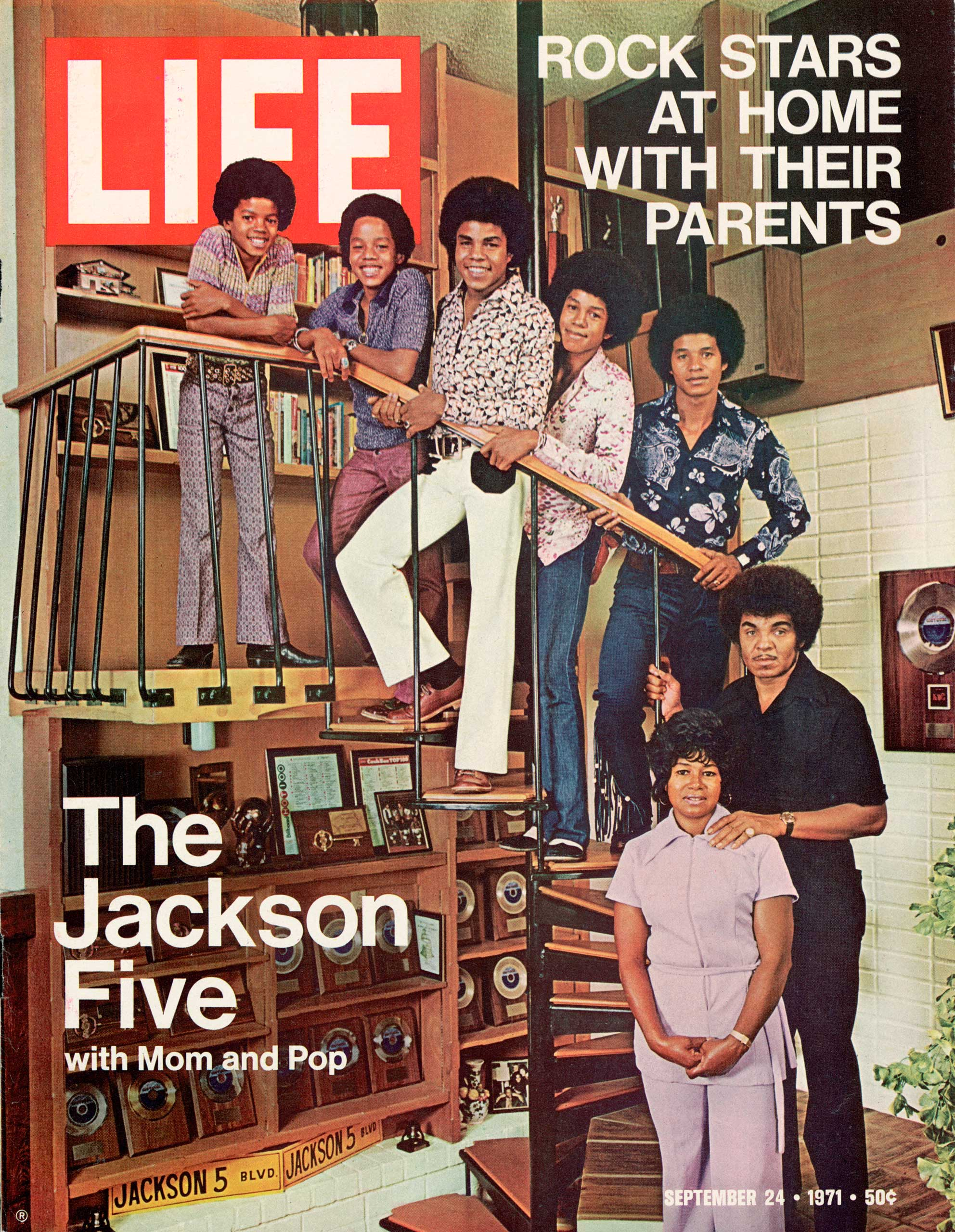 The Jackson 5 pose with their parents in Encino, Calif., in 1970.