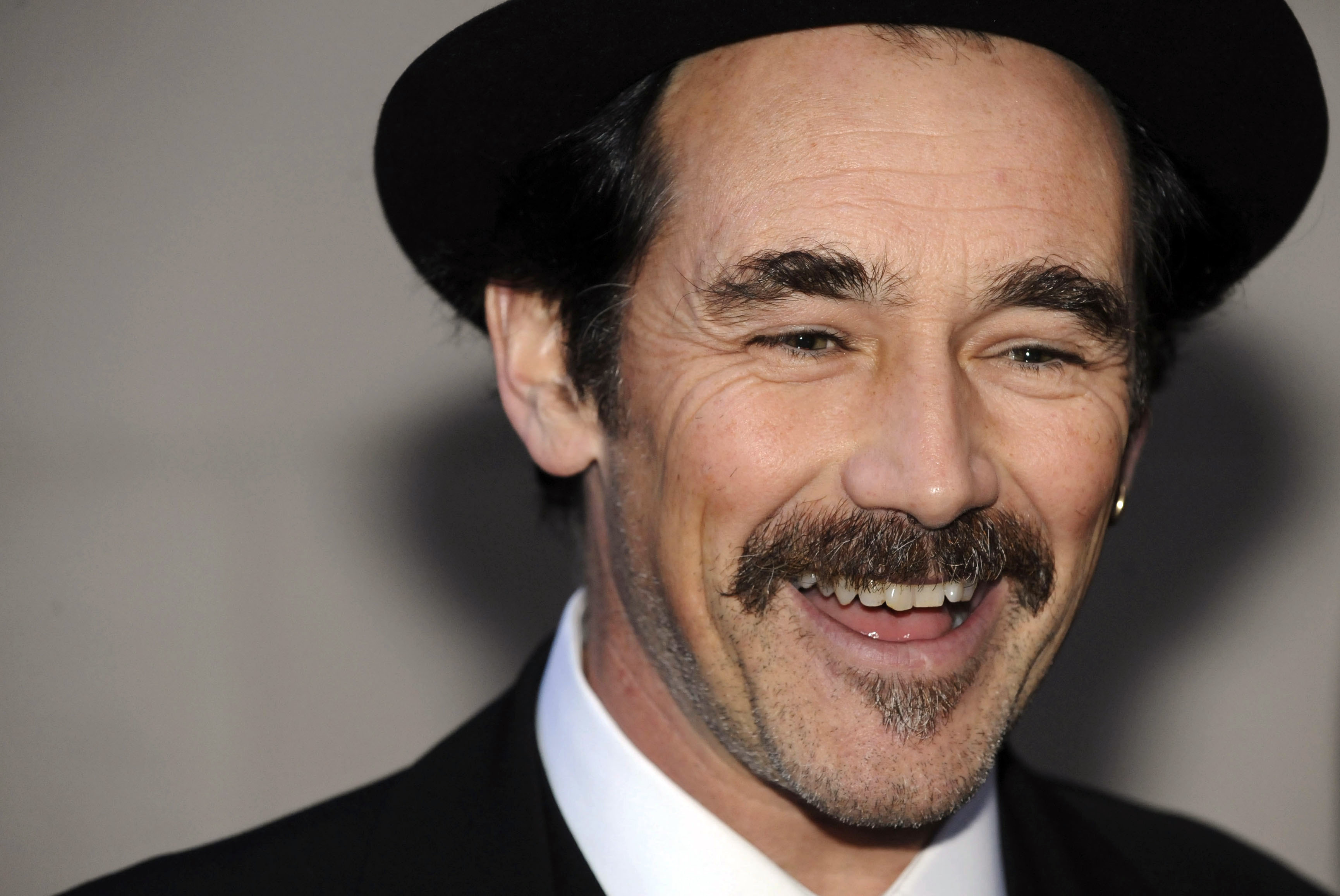 British actor Mark Rylance talks to the media as he arrives to attend the 2010 Laurence Olivier Awards in central London on March 21, 2010
