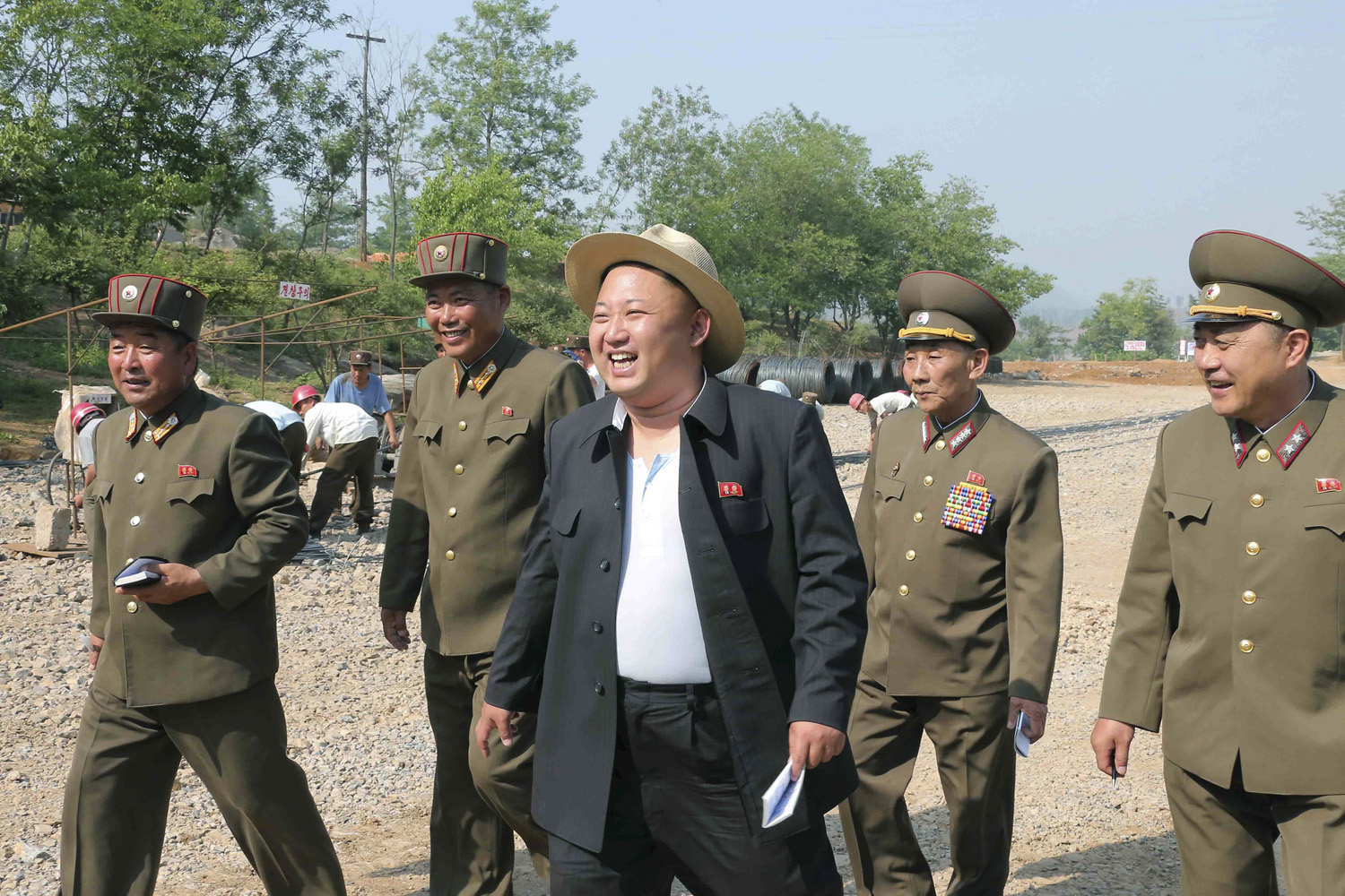 North Korean leader Kim Jong Un (C) visits a construction site of a resort for scientists in this undated photo released by North Korea's Korean Central News Agency (KCNA) in Pyongyang May 29, 2014.