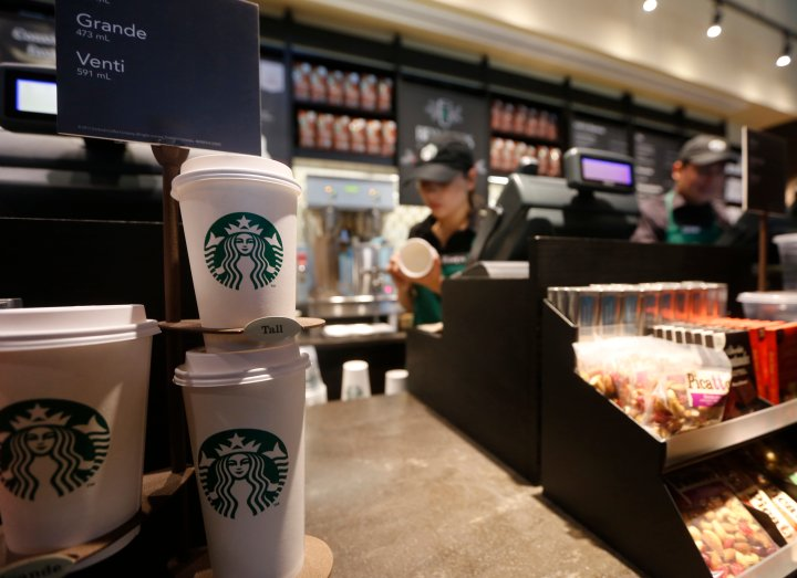 Paper cups of different sizes are seen on display at Starbuck's first Colombian store at 93 park in Bogota