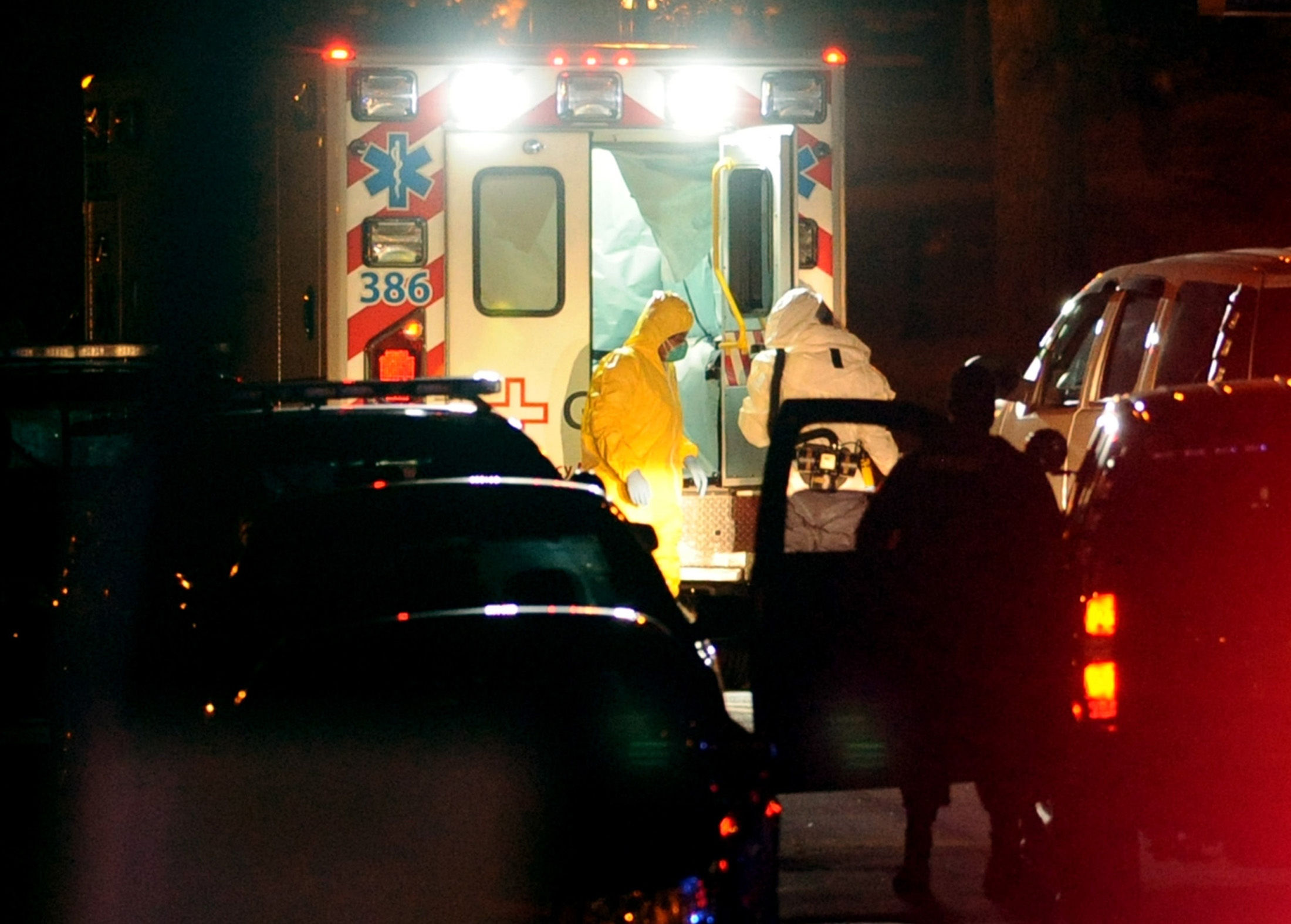 Texas nurse Amber Vinson, left, steps from an ambulance at Emory University Hospital in Atlanta, Ga., on Oct. 15, 2014.
