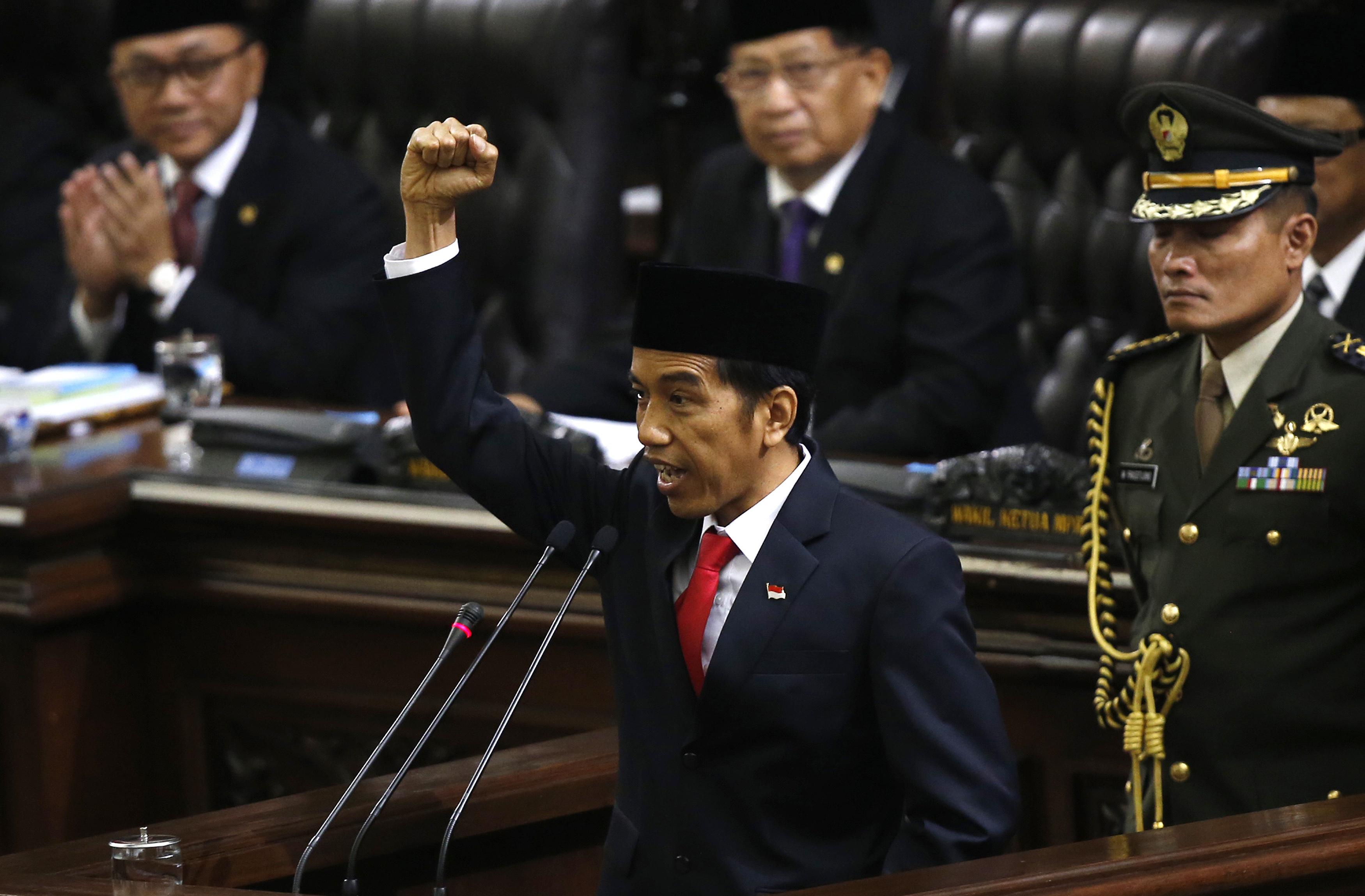 Indonesia's new President Joko Widodo shouts  Merdeka,  meaning freedom, at the end of his speech, during his inauguration at the parliament's building in Jakarta on Oct. 20, 2014