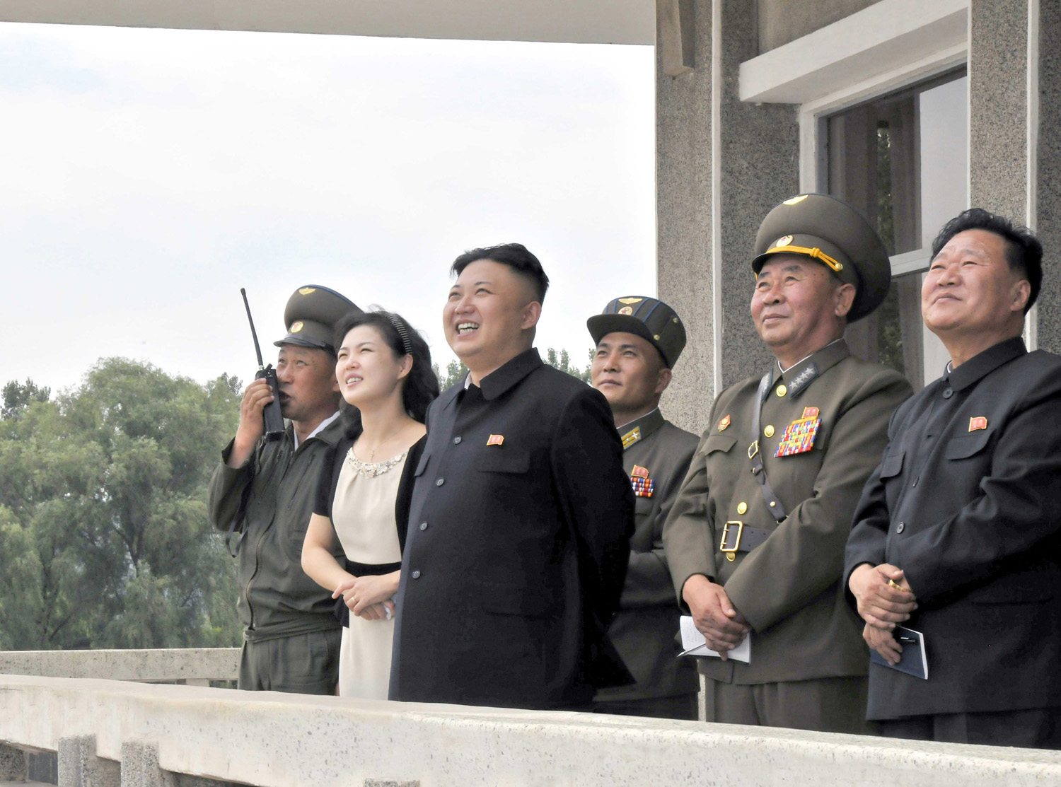 North Korean leader Kim Jong-un (3rd L) and his wife Ri Sol-ju (2nd L) look on during a visit to Unit 1017 of the Korean People's Army (KPA) Air and Anti-Air Force, honoured with the title of O Jung Hup-led 7th Regiment, in this undated picture released by North Korea's Korean Central News Agency (KCNA) on June 21, 2013.
