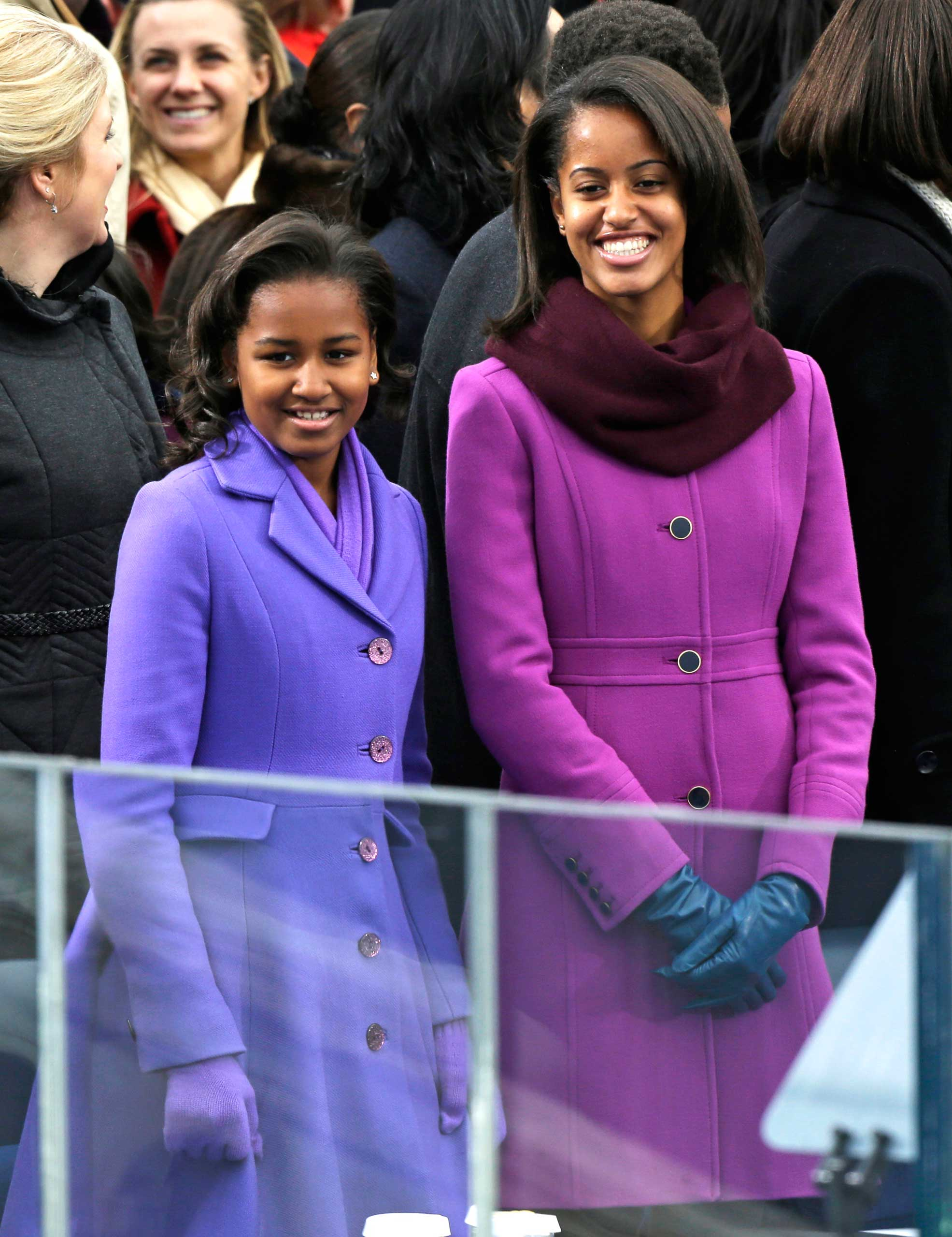 Sasha and Malia Obama arrive at the ceremonial swearing-in of their father President Barack Obama at the U.S. Capitol during the 57th Presidential Inauguration in Washington, Monday, Jan. 21, 2013. (AP Photo/Pablo Martinez Monsivais)