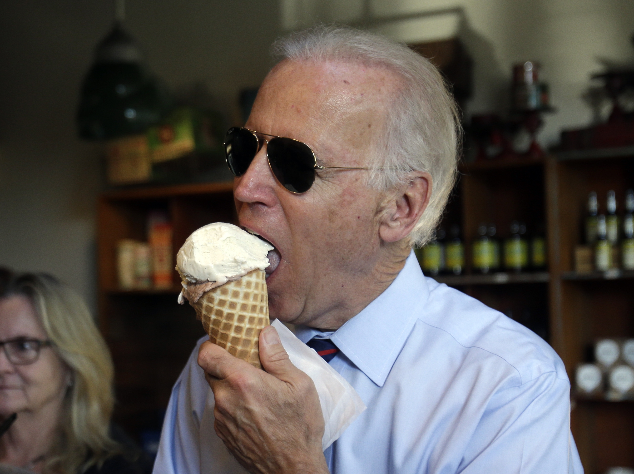 Vice President Joe Biden enjoys an ice cream cone after a campaign rally for Oregon U.S. Sen. Jeff Merkley in Portland, Ore., Wednesday, Oct. 8, 2014.