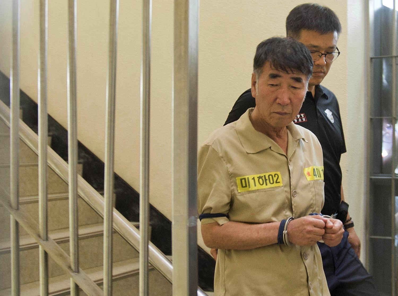 Lee Joon-seok, the captain of the sunken South Korean ferry Sewol, arrives at Gwangju District Court in Gwangju, South Korea, on June 10, 2014