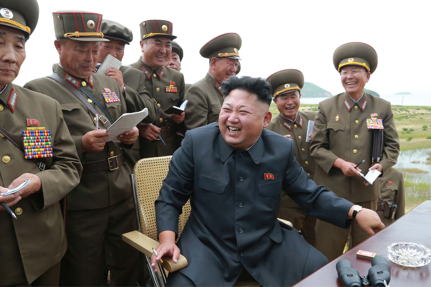 The photo provided by KCNA on Aug. 15, 2014 shows top leader of the Democratic People's Republic of Korea (DPRK) Kim Jong Un (C) guides the test-fire of a  Korean style ultra-precision high-performance tactical rocket  on the occasion of the 69th anniversary of the nation's liberation.