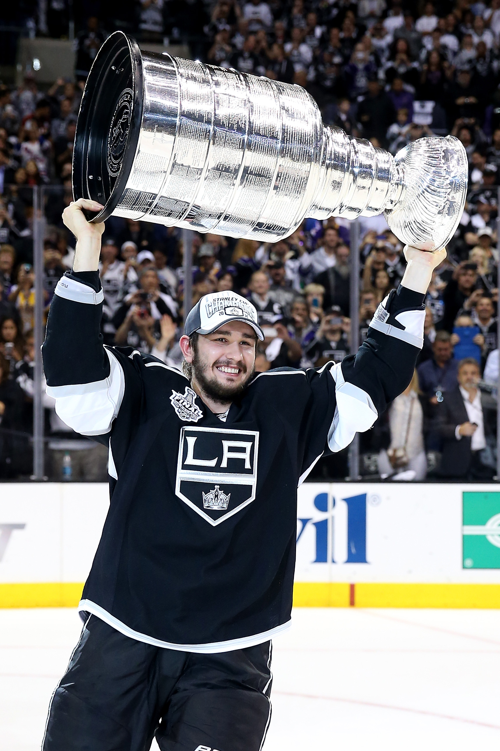 Slava Voynov of the Los Angeles Kings celebrates with the Stanley Cup after the Kings 3-2 double overtime victory against the New York Rangers in Game Five of the 2014 Stanley Cup Final at Staples Center on June 13, 2014 in Los Angeles.