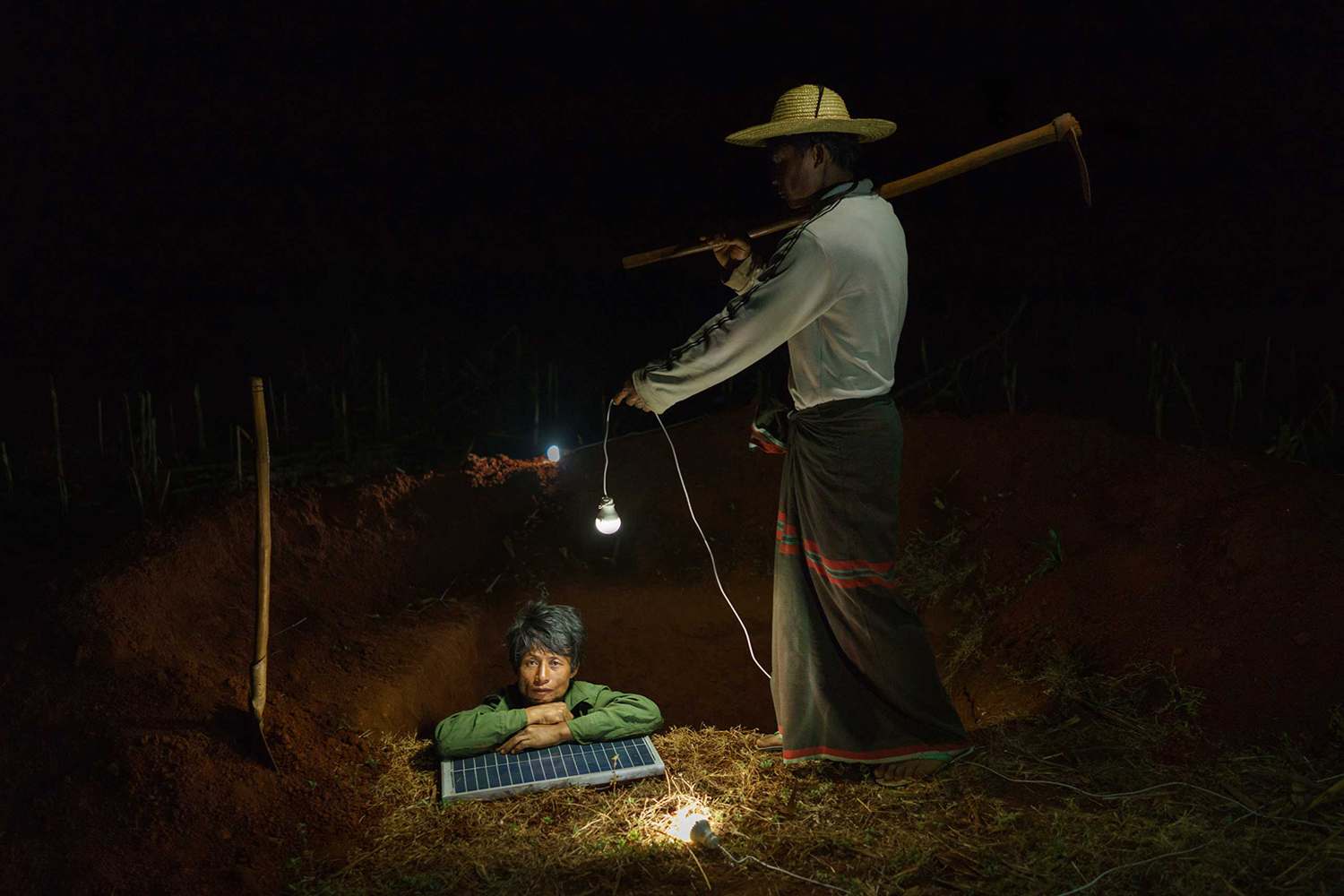 Construction workers dig a household latrine in Pa Dan Kho Village, Kayah State, Burma.