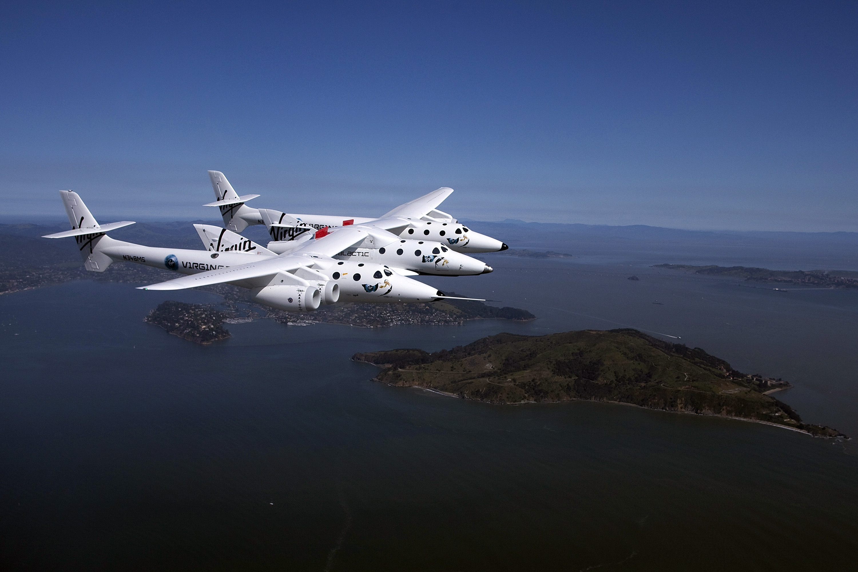 Virgin Galactic's private SpaceShipTwo spacecraft flies over the San Francisco Bay in San Francisco on April 6, 2011.