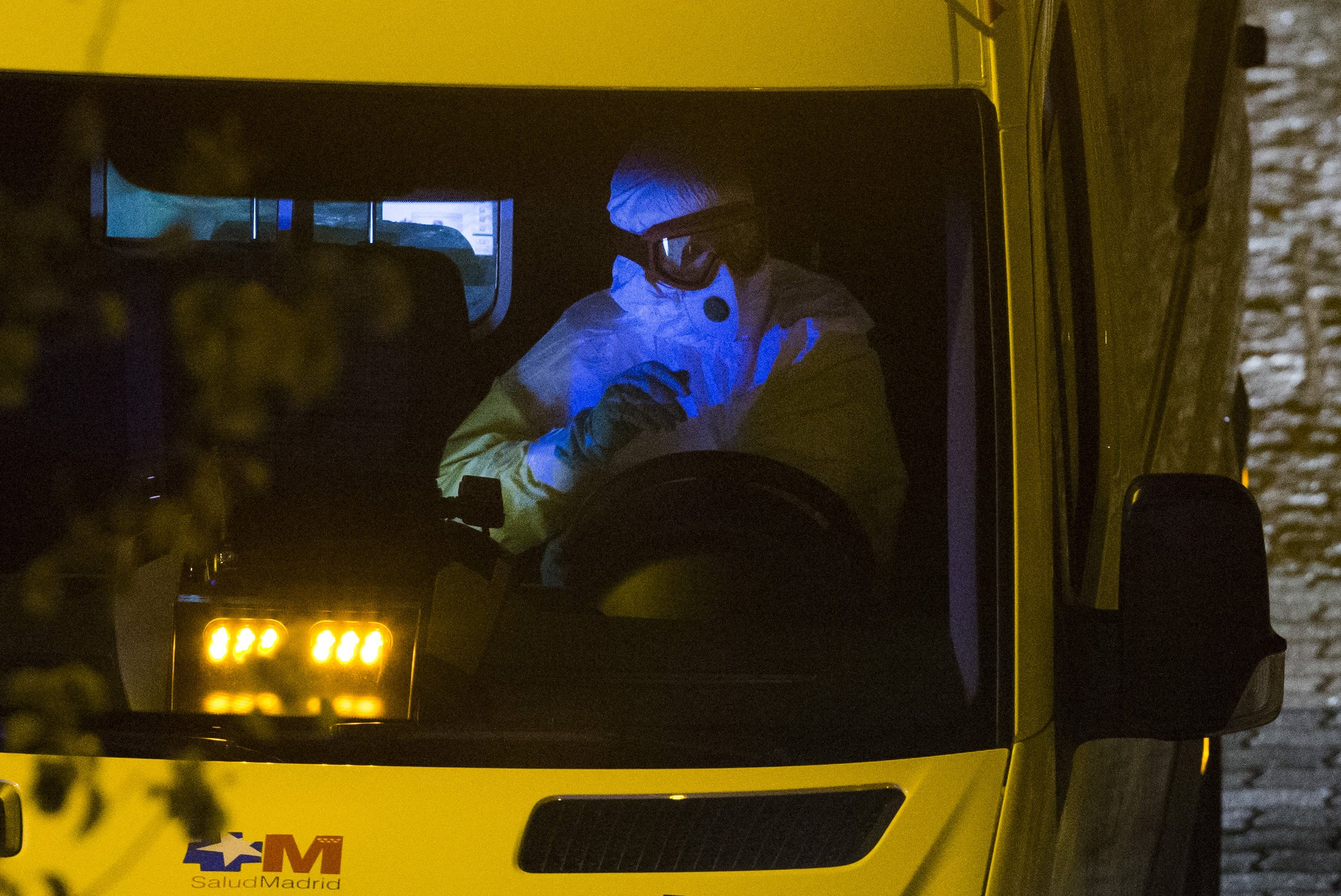 An ambulance transporting a Spanish nurse who is believed to have contracted the ebola virus from a 69-year-old Spanish priest leaves Alcorcon Hospital in Madrid on Oct. 7, 2014.