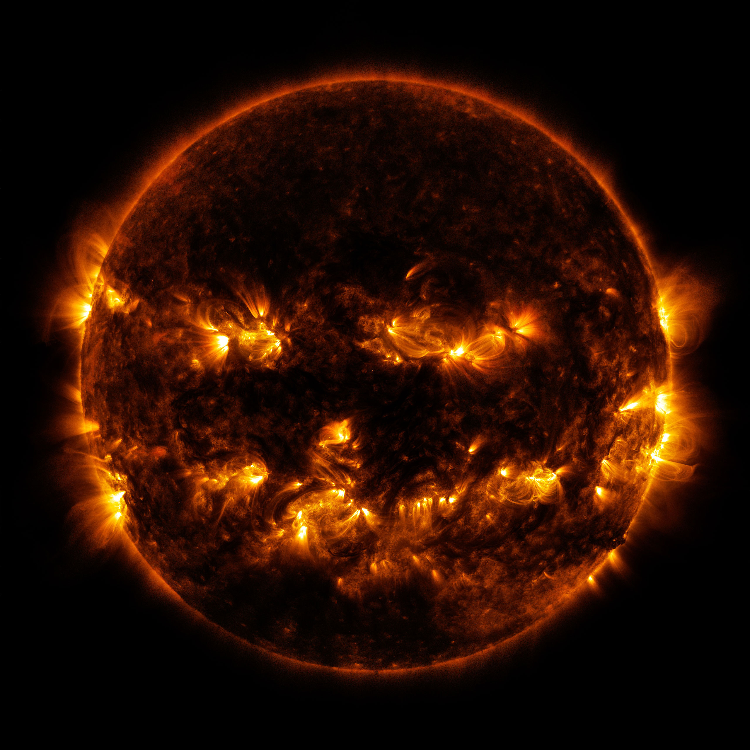 Jack-o-Lantern Sun Active regions on the sun combined to resemble a jack-o-lantern's face on Oct. 8, 2014. The active regions in this image appear brighter because they emit more light and energy.