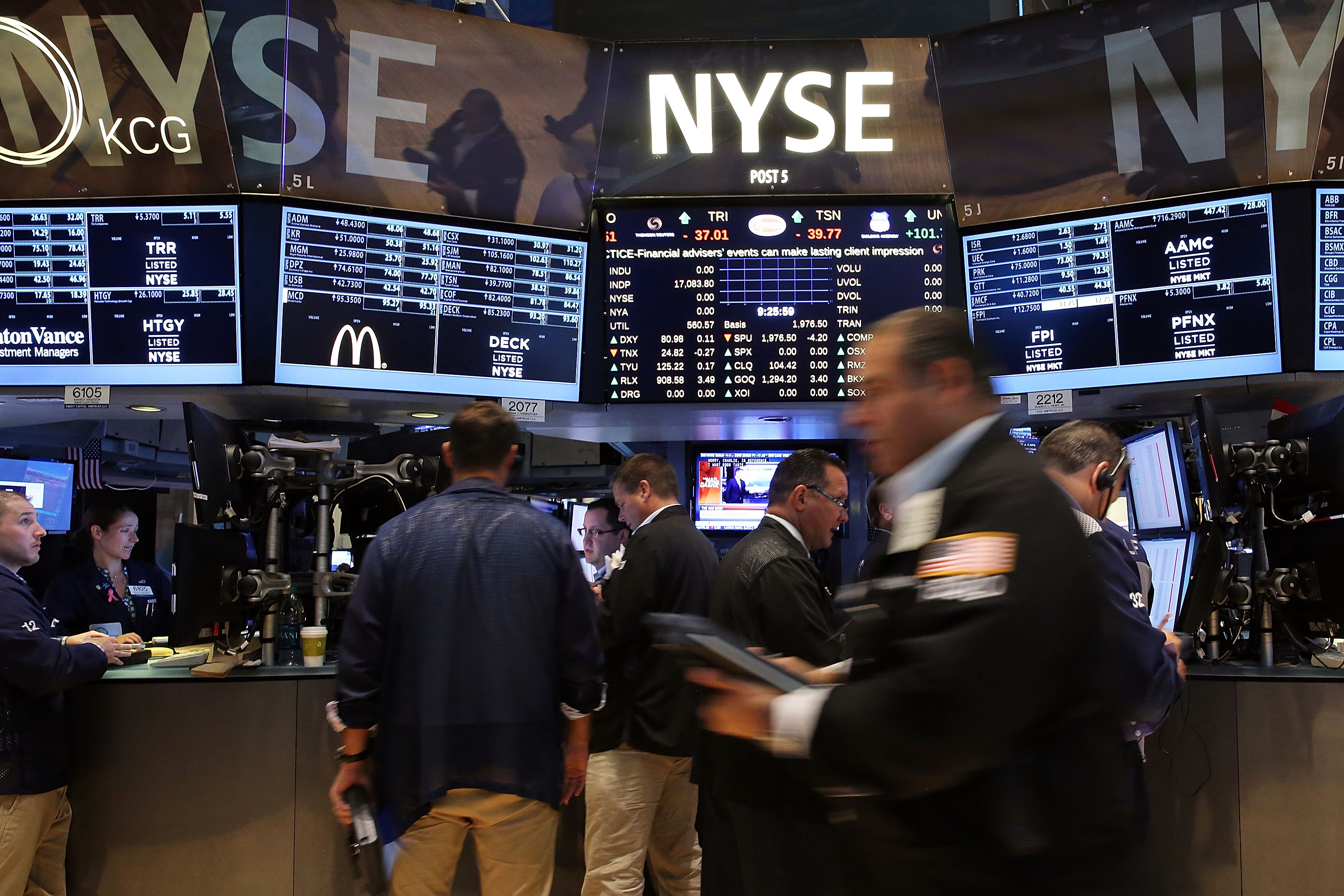 Traders work on the floor of the New York Stock Exchange (NYSE) on July 25, 2014 in New York City.