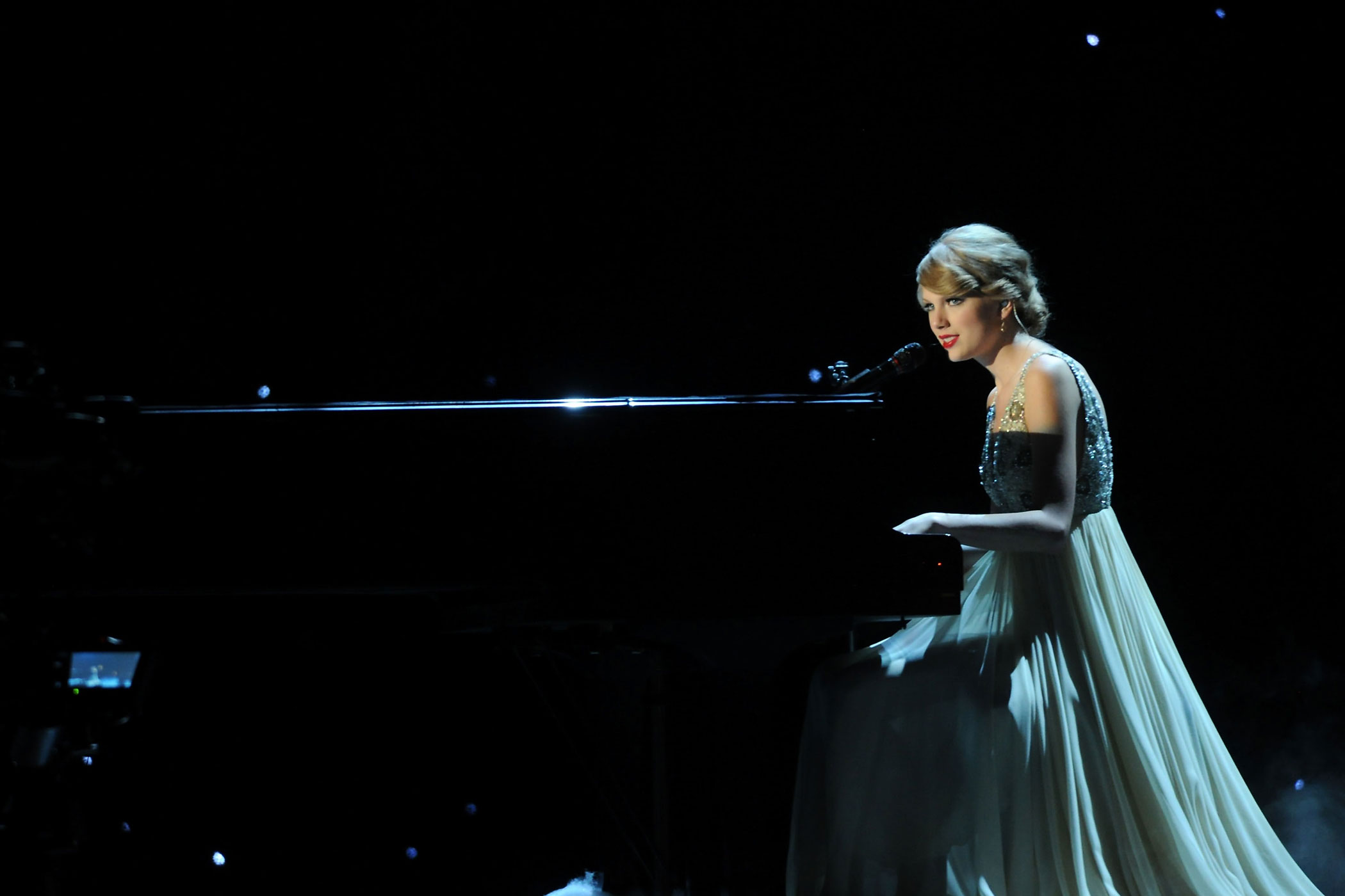 "Taylor Swift performs ""Back to December"" at the 44th Annual CMA Awards at the Bridgestone Arena in Nashville, Tennessee in 2010."