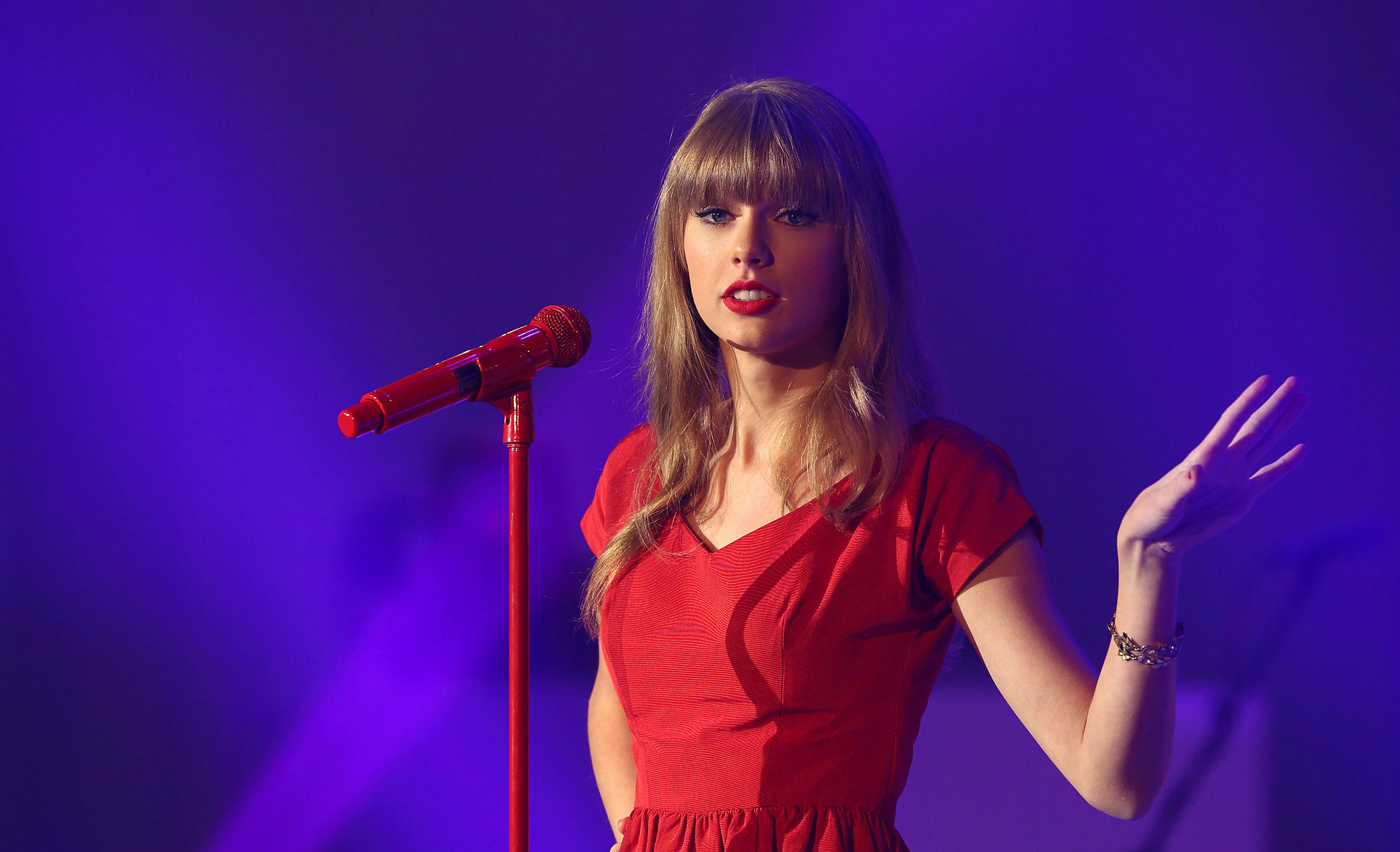 Taylor Swift switches on the Christmas lights and performs for fans and shoppers at Westfield London in London, England in 2012.