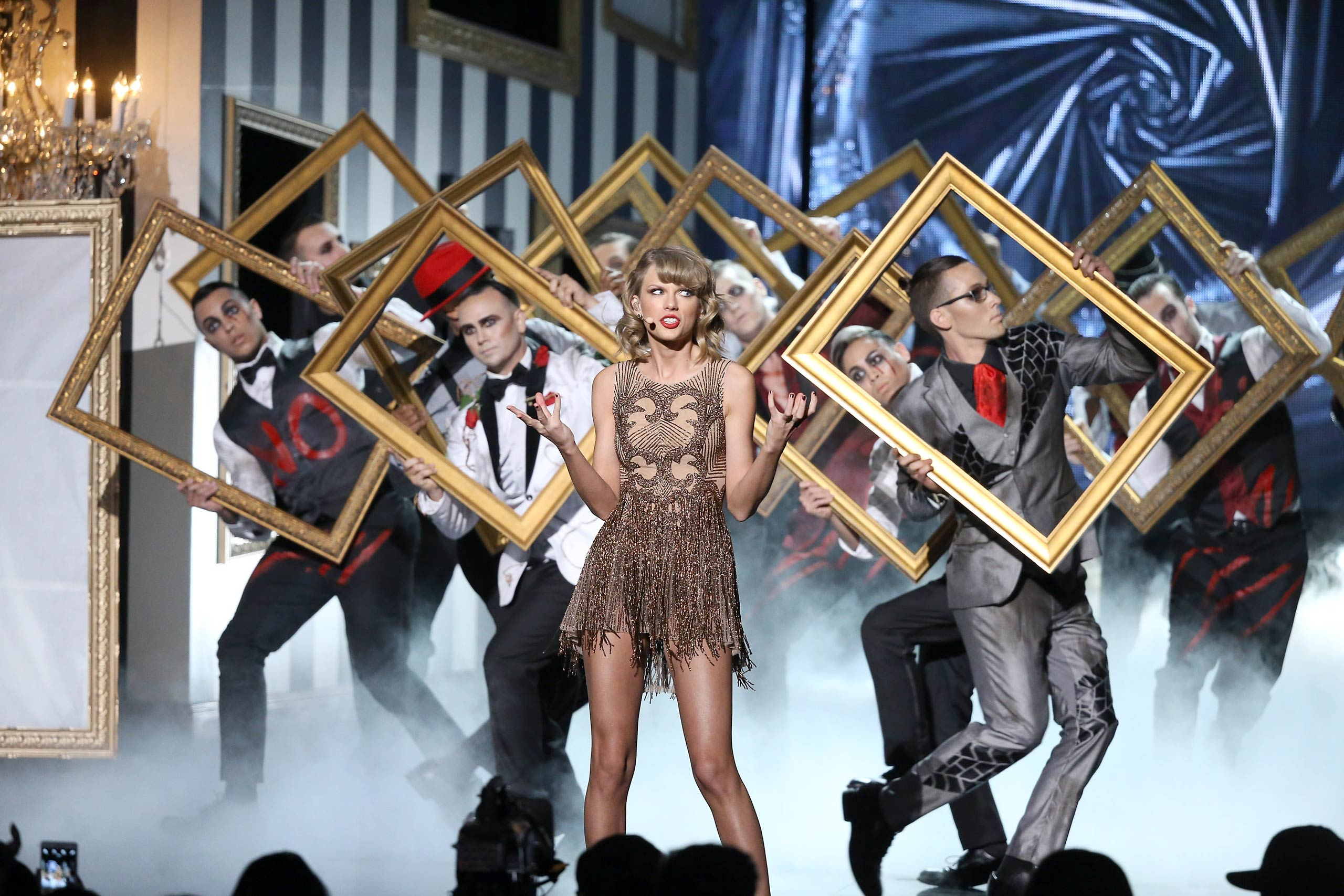 Taylor Swift performs onstage during the 2014 American Music Awards held at Nokia Theatre L.A. Live on Nov. 23, 2014 in Los Angeles, Ca.
