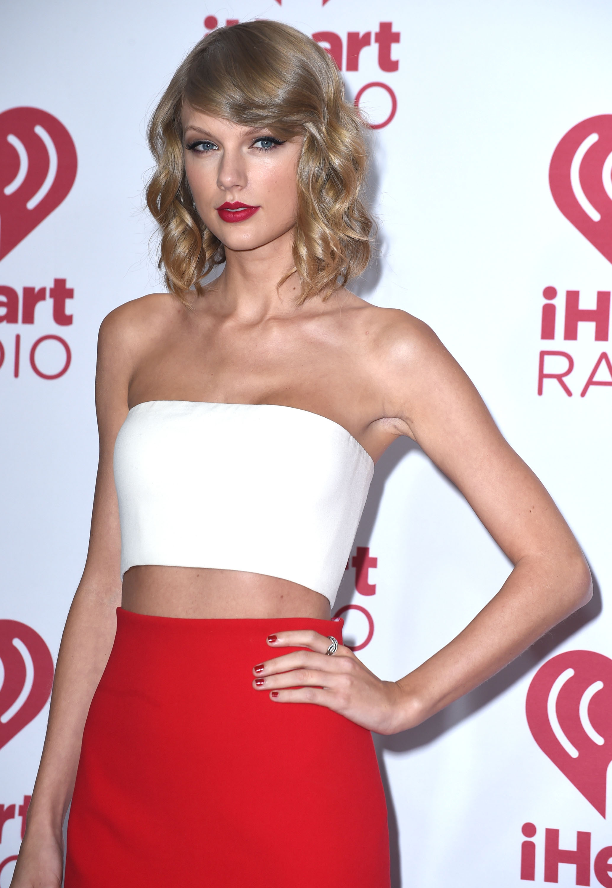 Taylor Swift poses at the 2014 iHeartRadio Music Festival - Night 1 - Press Room at MGM Grand Garden Arena on September 19, 2014 in Las Vegas, Nevada.