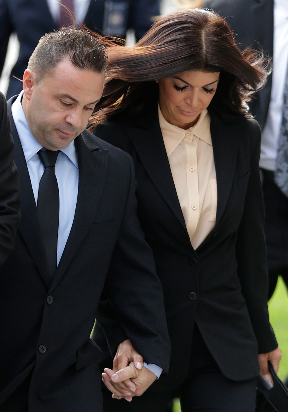 The Real Housewives of New Jersey  stars Giuseppe  Joe  Giudice, left, and his wife, Teresa Giudice, of Montville Township, N.J., walk toward Martin Luther King Jr. Courthouse before a court appearance, Thursday, Oct. 2, 2014, in Newark, N.J.