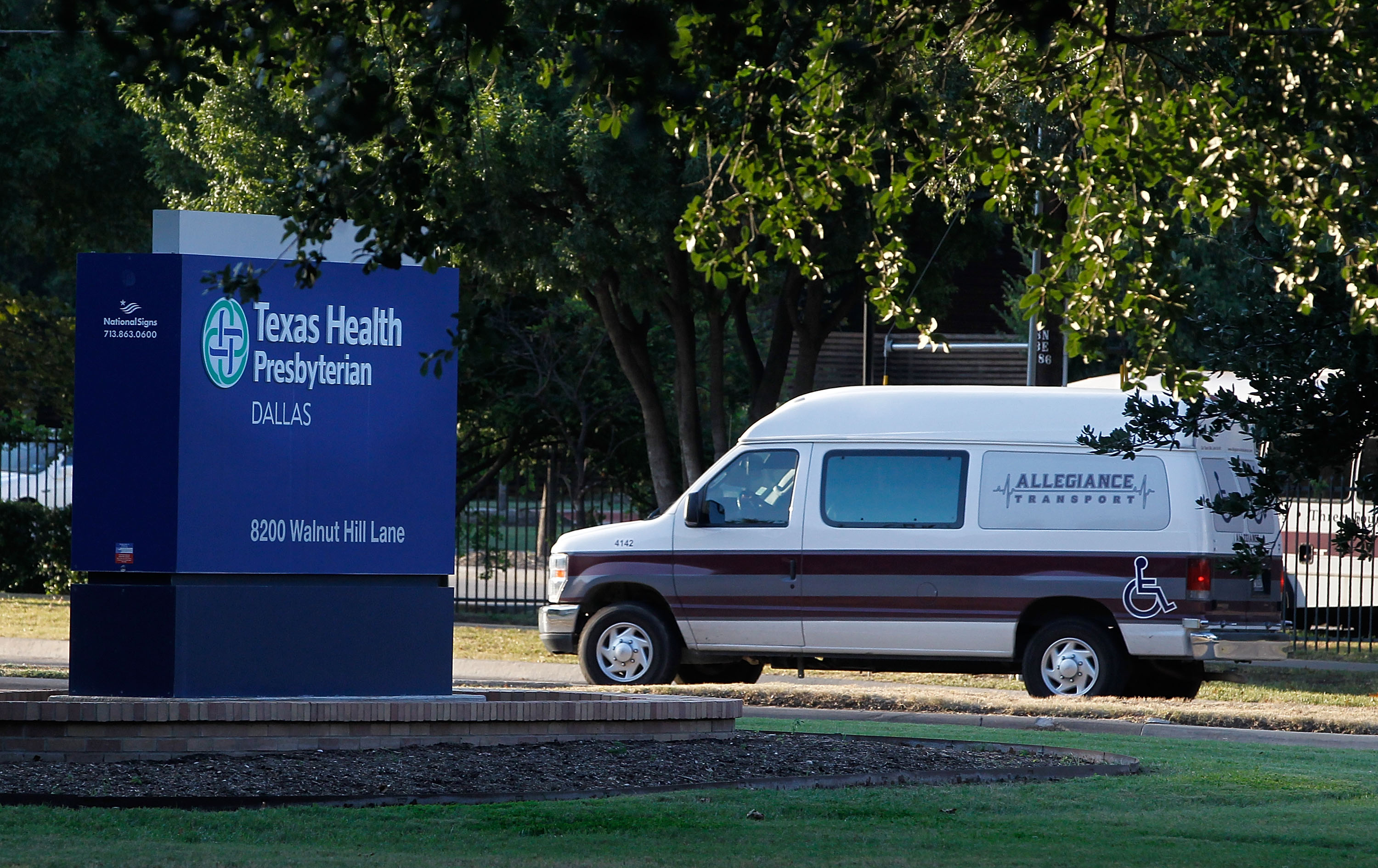 A medical transport van moves past Texas Health Presbyterian Hospital Dallas where a patient has been diagnosed with the Ebola virus on September 30, 2014 in Dallas, Texas.